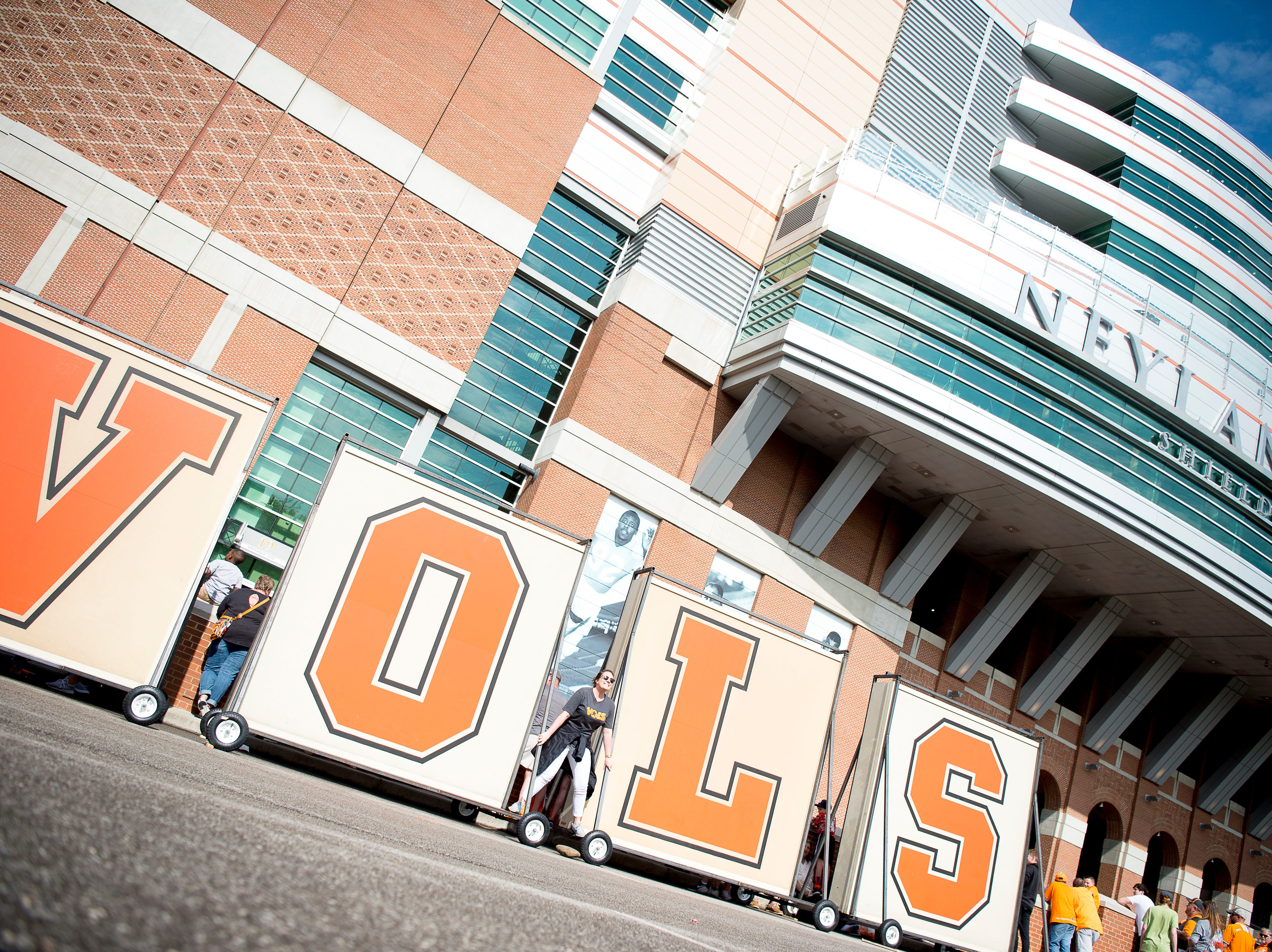 """The old """"Vols"""" sign that once stood atop Neyland Stadium are on display at the Tennessee Spring Game at Neyland Stadium in Knoxville, Tennessee on Saturday, April 13, 2019."""