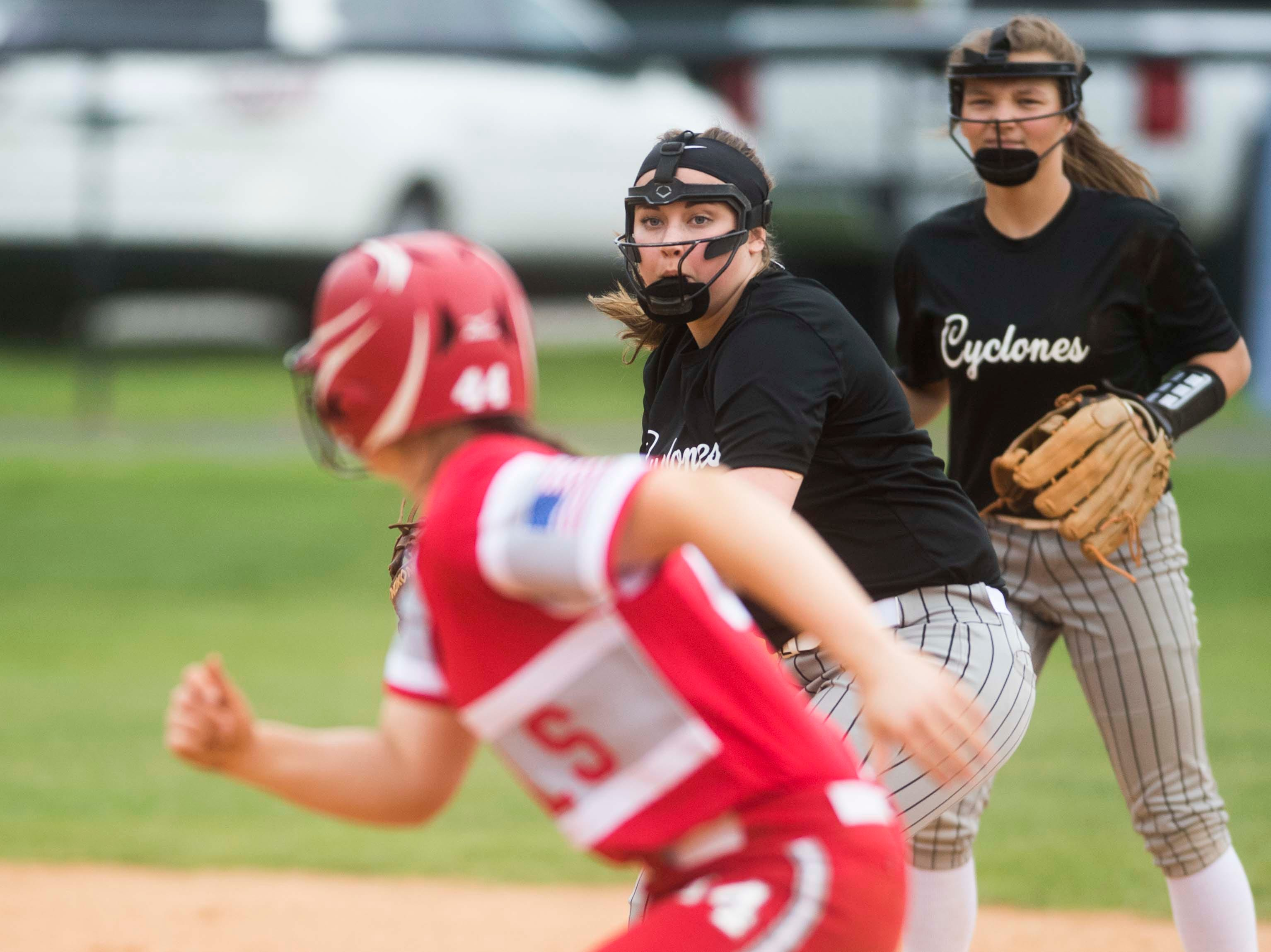 Elizabethton players play a game of chicken with a Halls player between first and second during a high school softball game between Halls and Elizabethton at Halls Friday, April 12, 2019. Halls defeated Elizabethton.