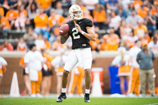 Quarterback Jarrett Guarantano throws a pass during the Tennessee spring game in Neyland Stadium on Saturday.