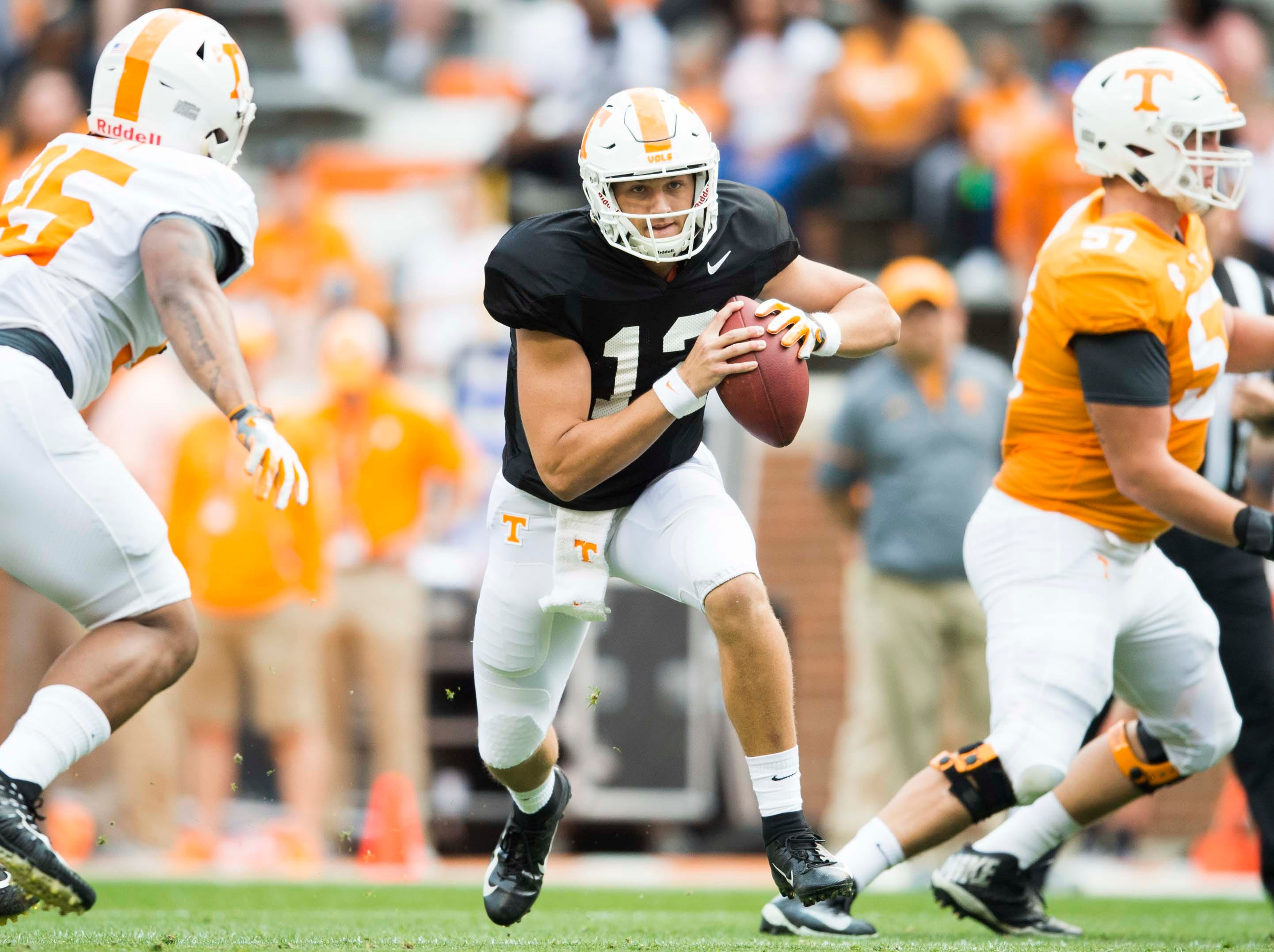 Tennessee quarterback J.T. Shrout (12) runs the ball during the Vols spring game in Neyland Stadium in Knoxville Saturday, April 13, 2019.