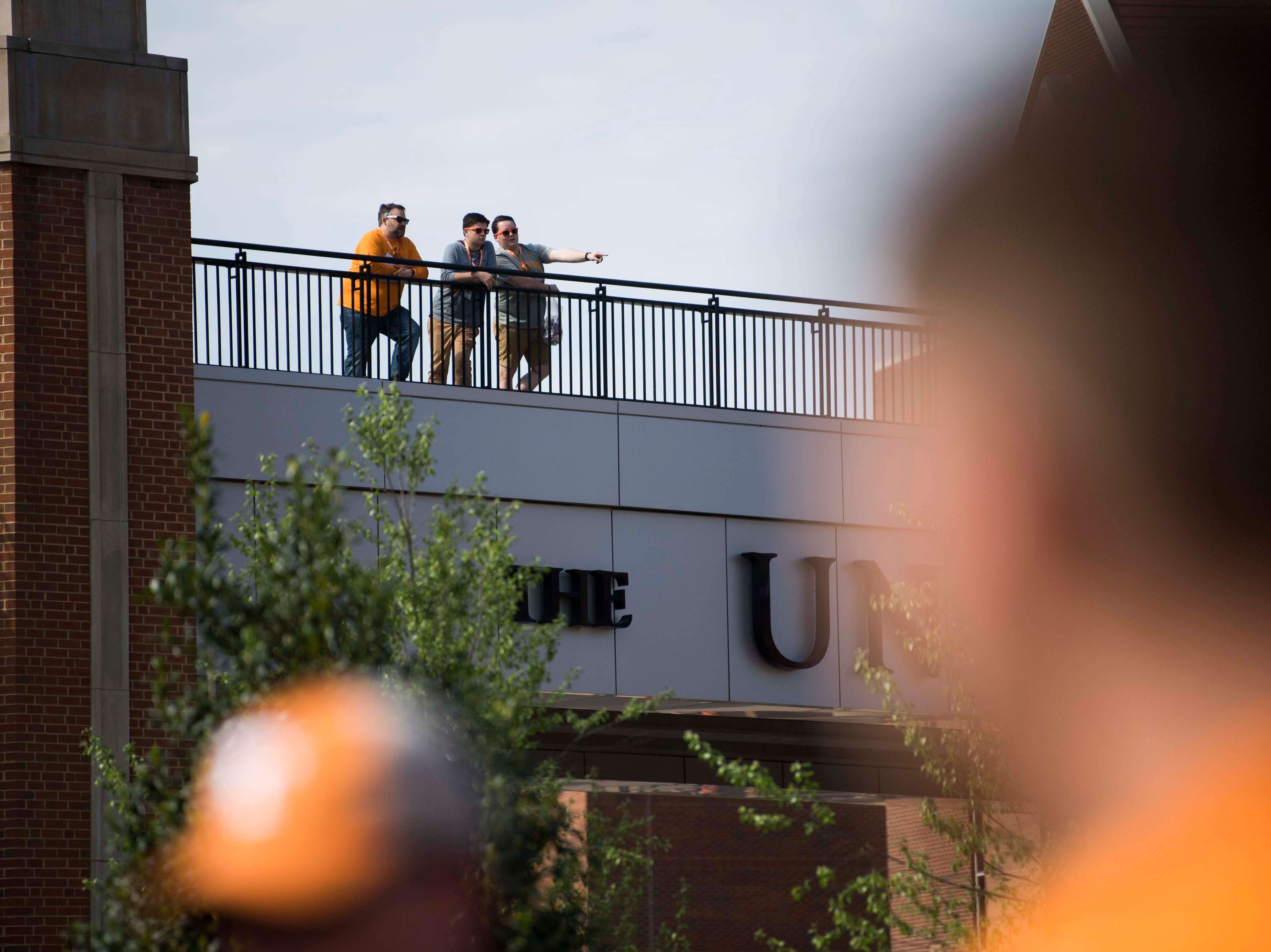 Fans stand on the pedestrian bridge while waiting for the Vols spring game to begin outside Neyland Stadium in Knoxville Saturday, April 13, 2019.