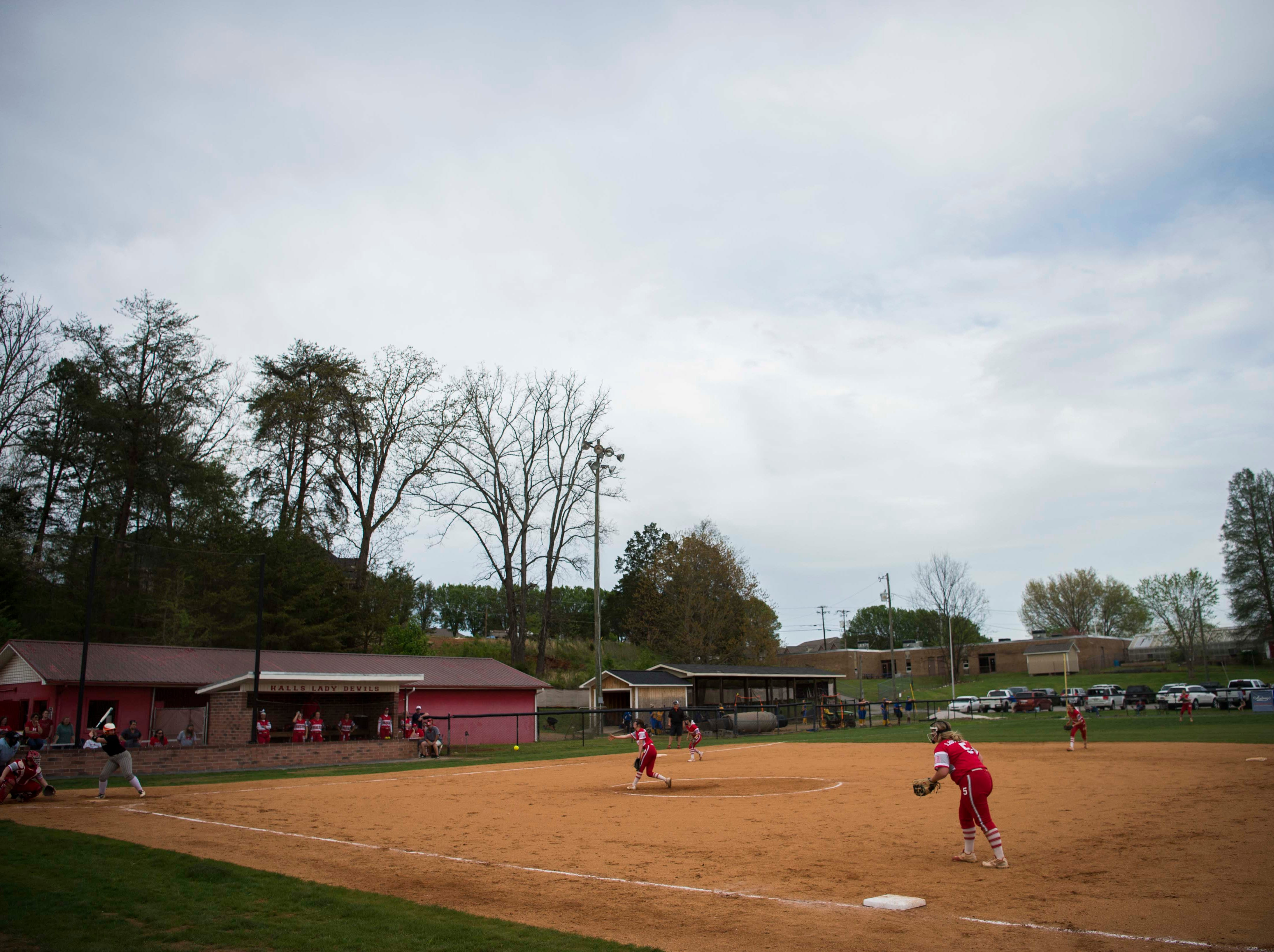 Play continues during a high school softball game between Halls and Elizabethton at Halls Friday, April 12, 2019. Halls defeated Elizabethton.