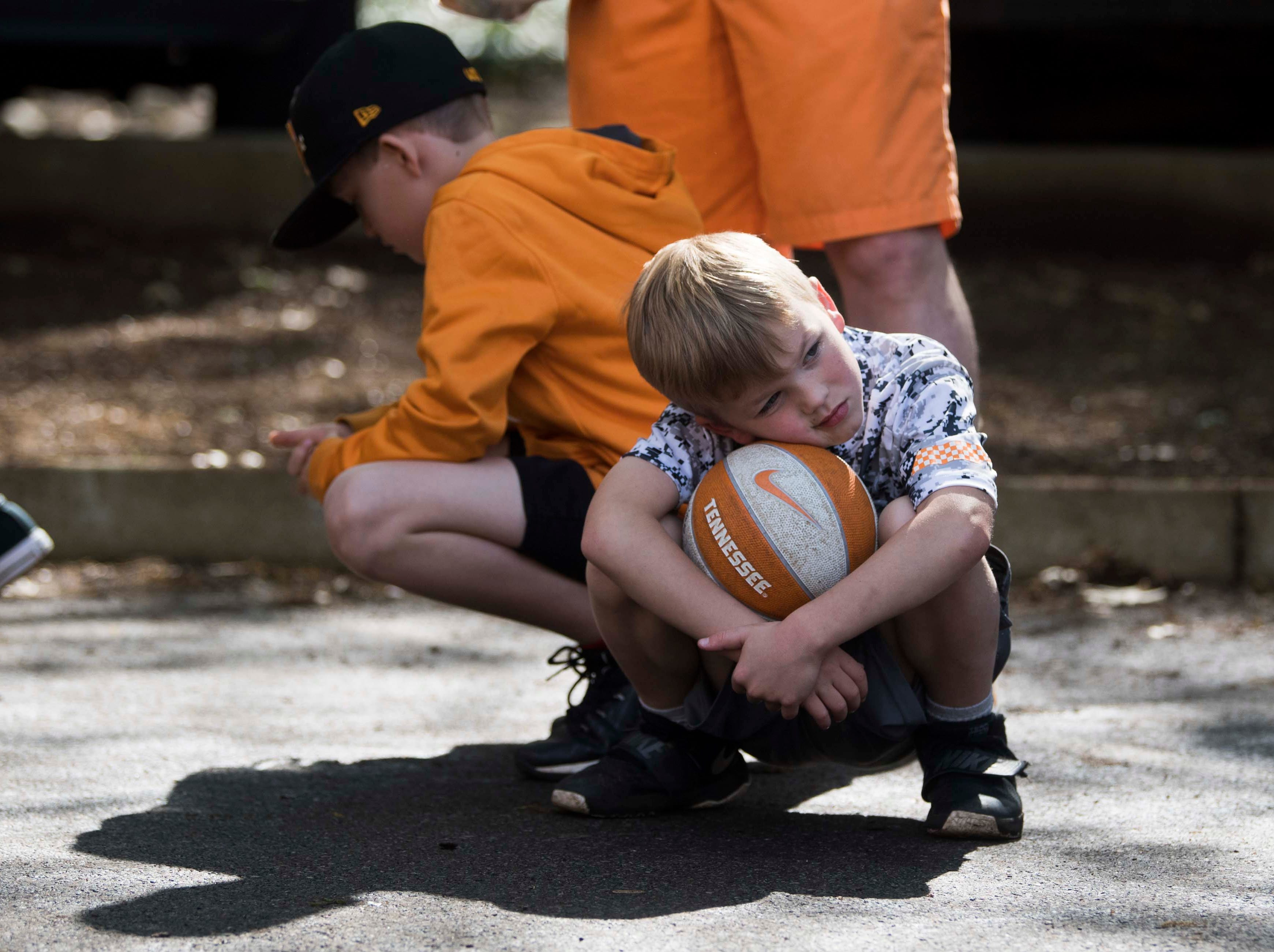 Ryan Morrison, 7, of Knoxville waits in the shade for the Vols spring game to begin outside Neyland Stadium in Knoxville Saturday, April 13, 2019.