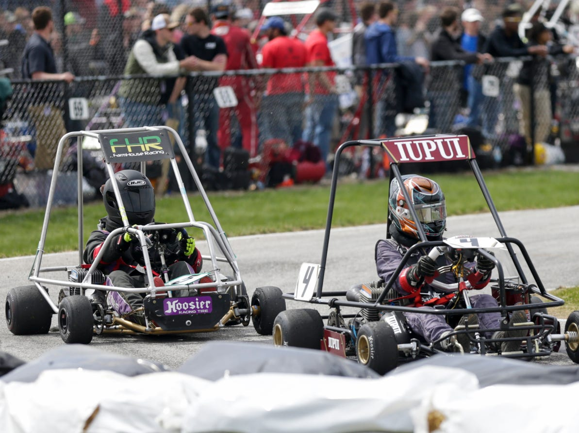 IUPUI Motorsports driver Brenden Johnson (4) laps FarmHouse Racing driver Austin Erdman (5) during the 62nd Grand Prix, Saturday, April 13, 2019, in West Lafayette.
