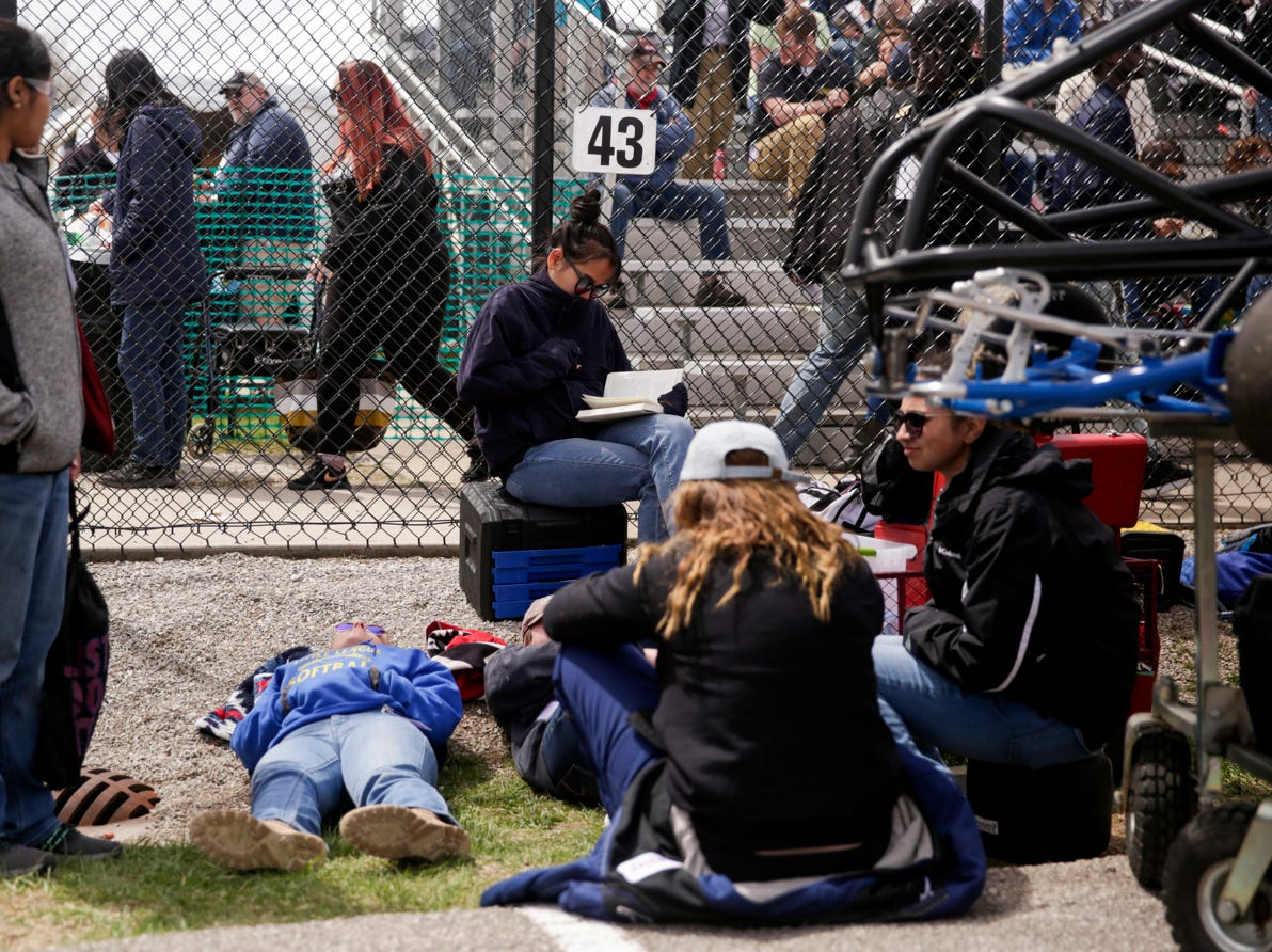 Pit crews rest before the start of the 62nd Grand Prix, Saturday, April 13, 2019, in West Lafayette.