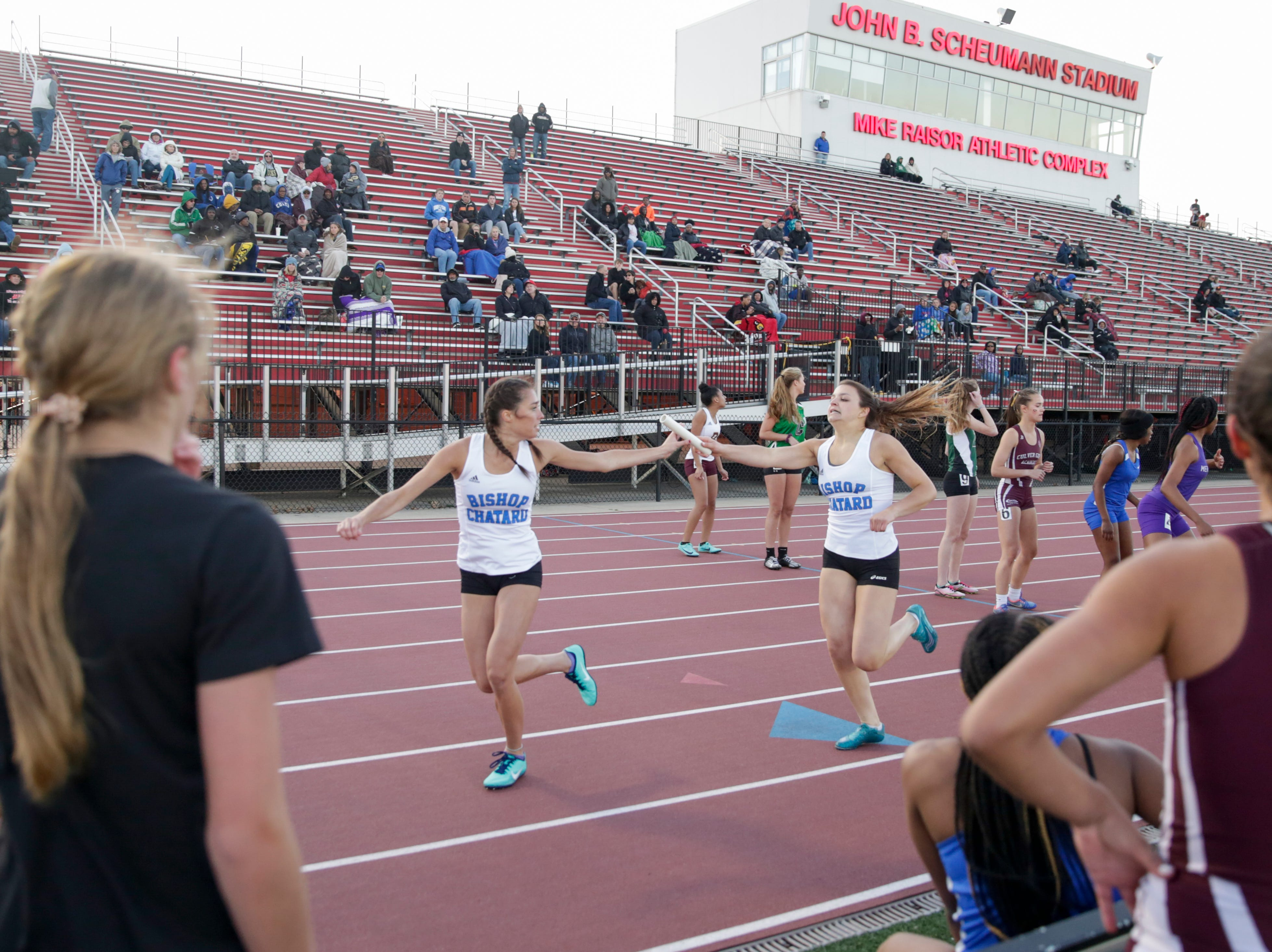 Runner's hand of the baton as they compete in the women's 4x400 meter relay during the 2019 Sprinters Showcase, Friday, April 12, 2019, at Lafayette Jeff High School in Lafayette.