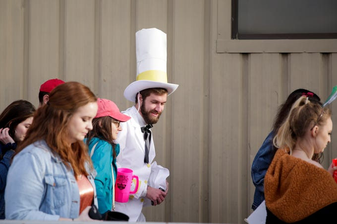 Skyler Settles, center, dressed as Doug Dimmadome from the Nickelodeon cartoon, Fairly Odd Parents, outside the Neon Cactus during Breakfast Club, Saturday, April 13, 2019, in West Lafayette.