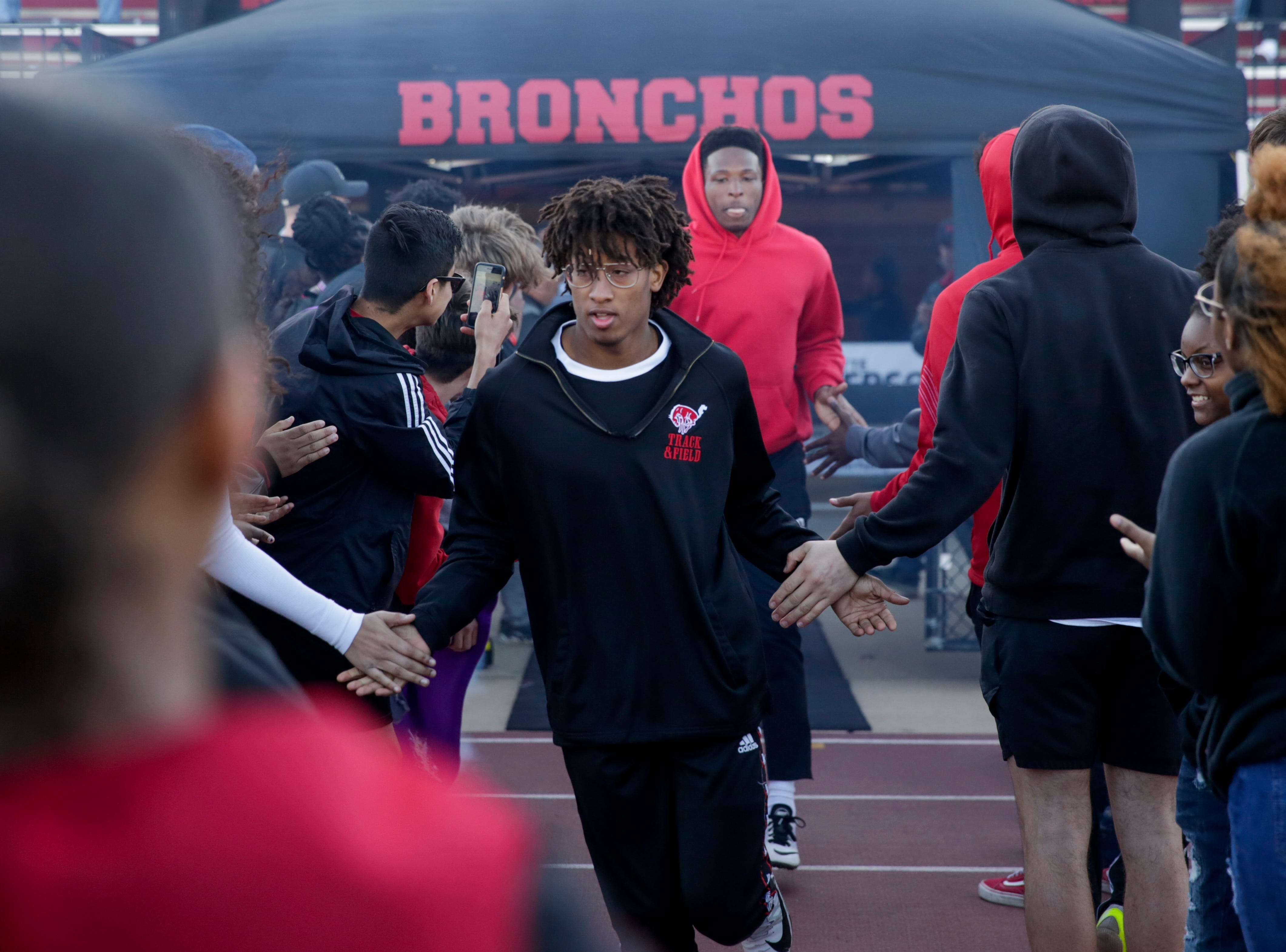 Lafayette Jeff's Thomas Hogan comes out of the tunnel before competing in the men's 4x100 meter relay during the 2019 Sprinters Showcase, Friday, April 12, 2019, at Lafayette Jeff High School in Lafayette.