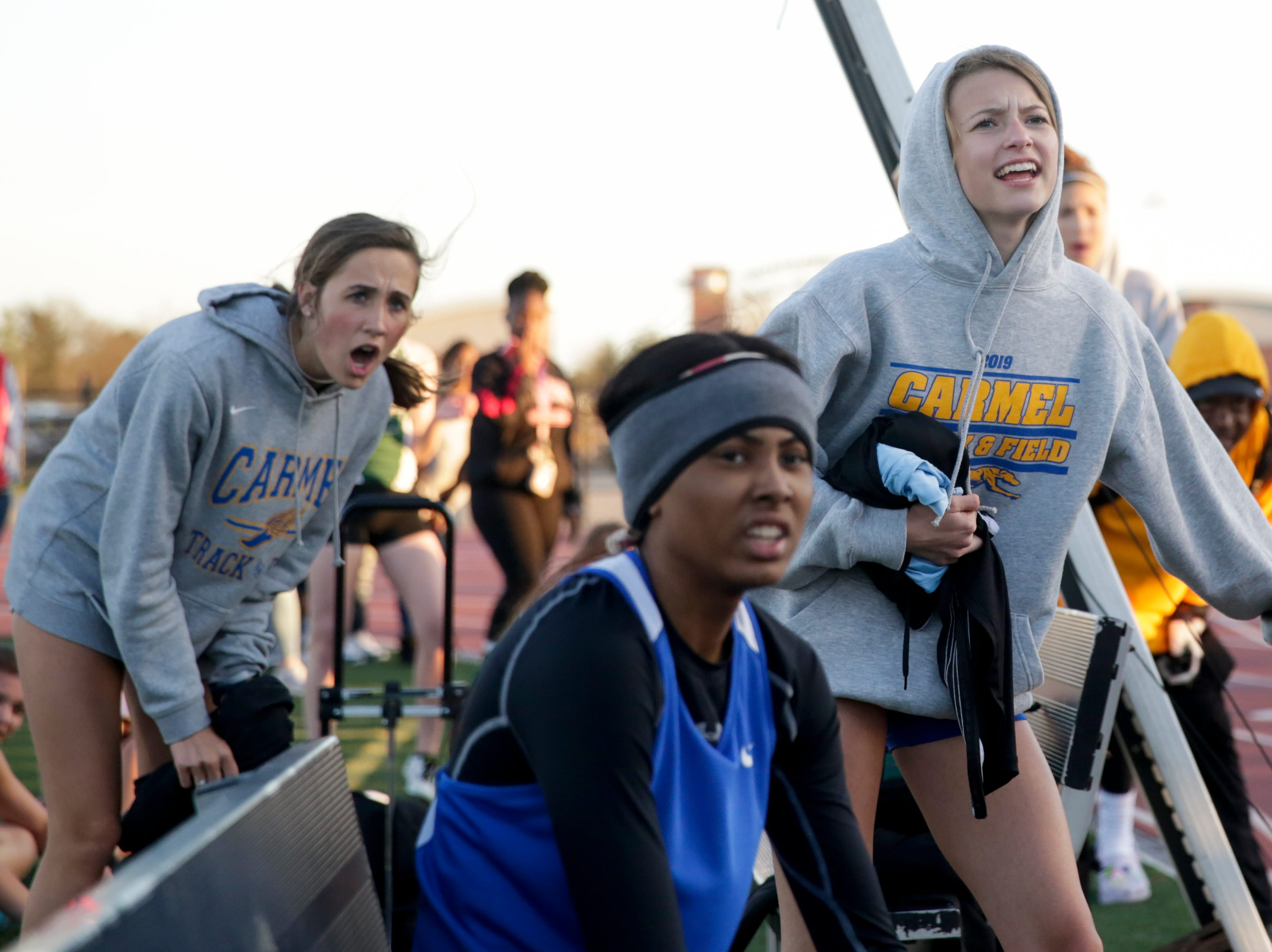 Competitors cheer on their teammates as they compete in the women's 4x400 meter relay during the 2019 Sprinters Showcase, Friday, April 12, 2019, at Lafayette Jeff High School in Lafayette.