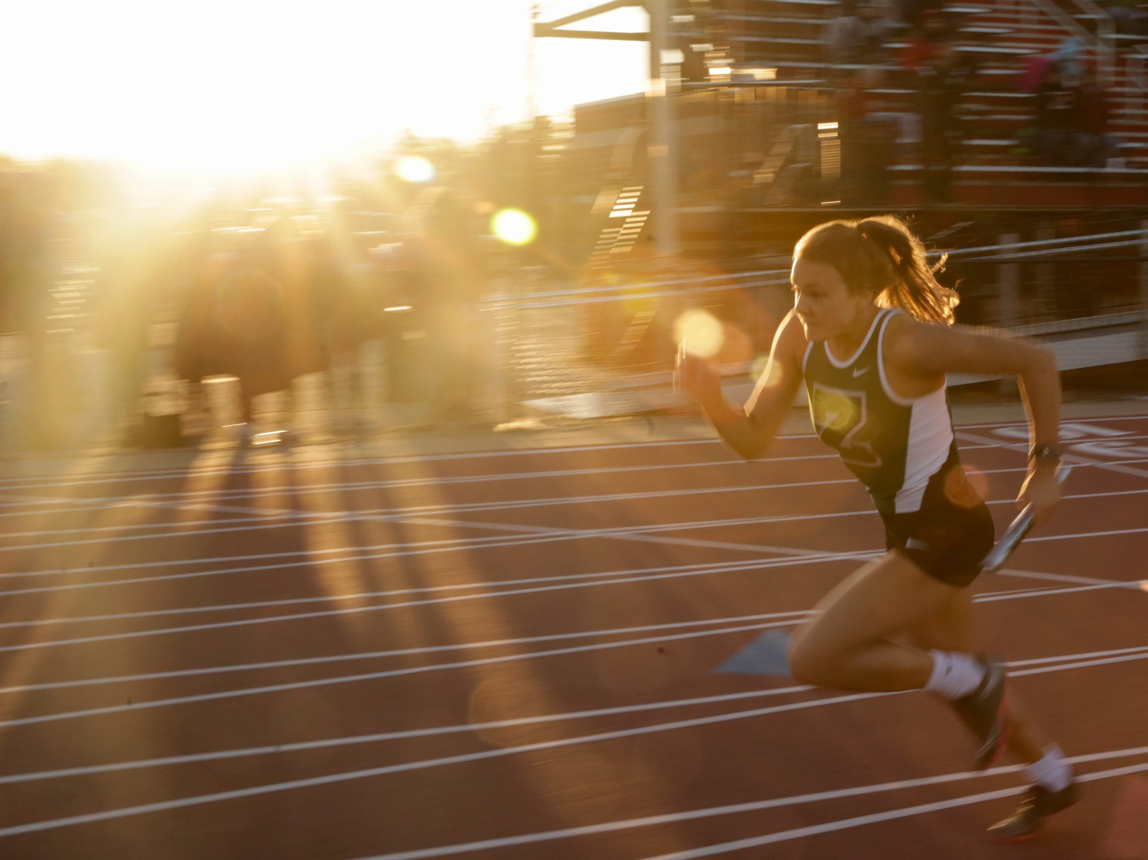 A runner competes in the women's 4x400 meter relay during the 2019 Sprinters Showcase, Friday, April 12, 2019, at Lafayette Jeff High School in Lafayette.