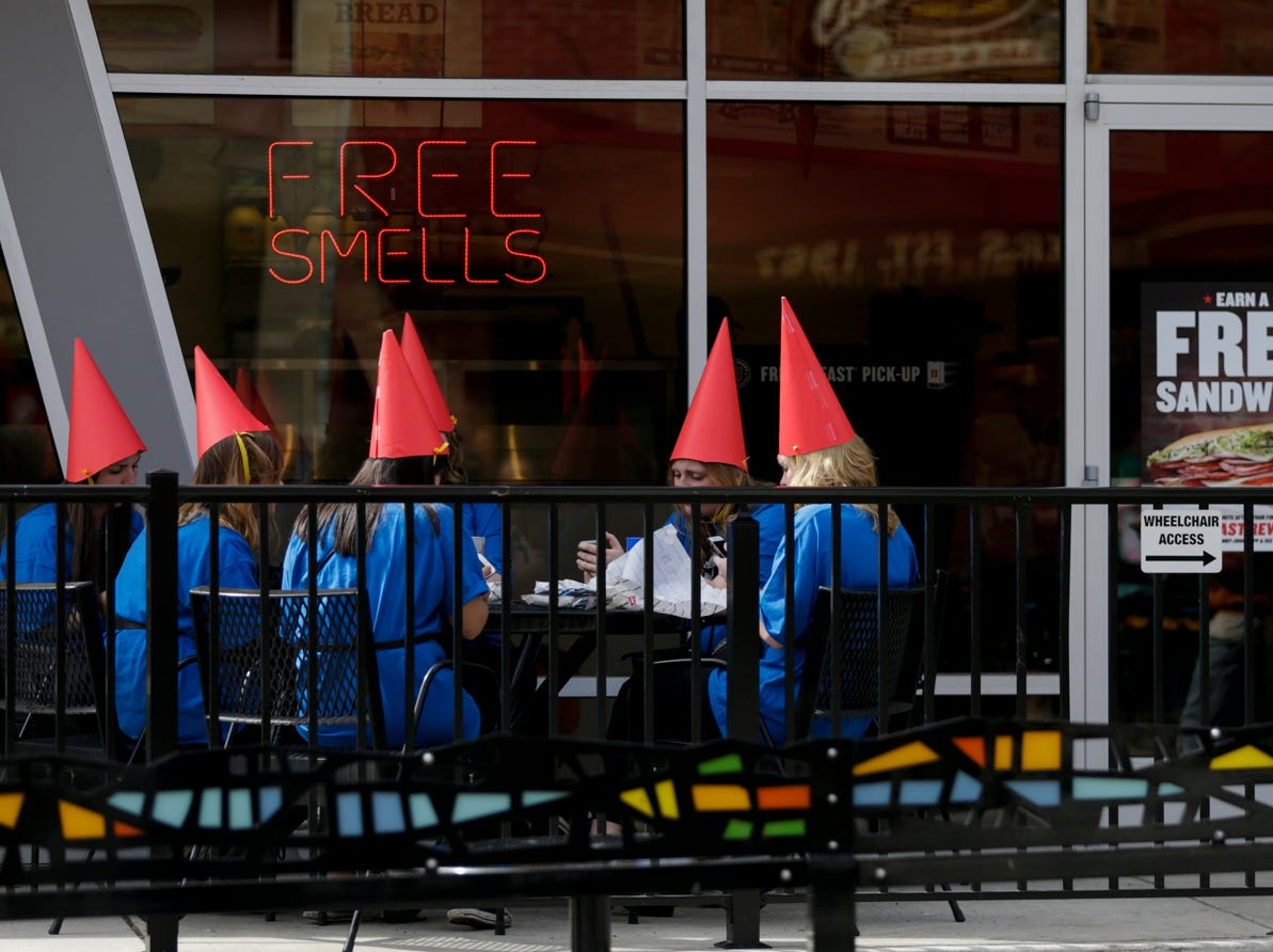 A group of gnomes eat outside of Jimmy Johns W. State st. during Breakfast Club, Saturday, April 13, 2019, in West Lafayette.