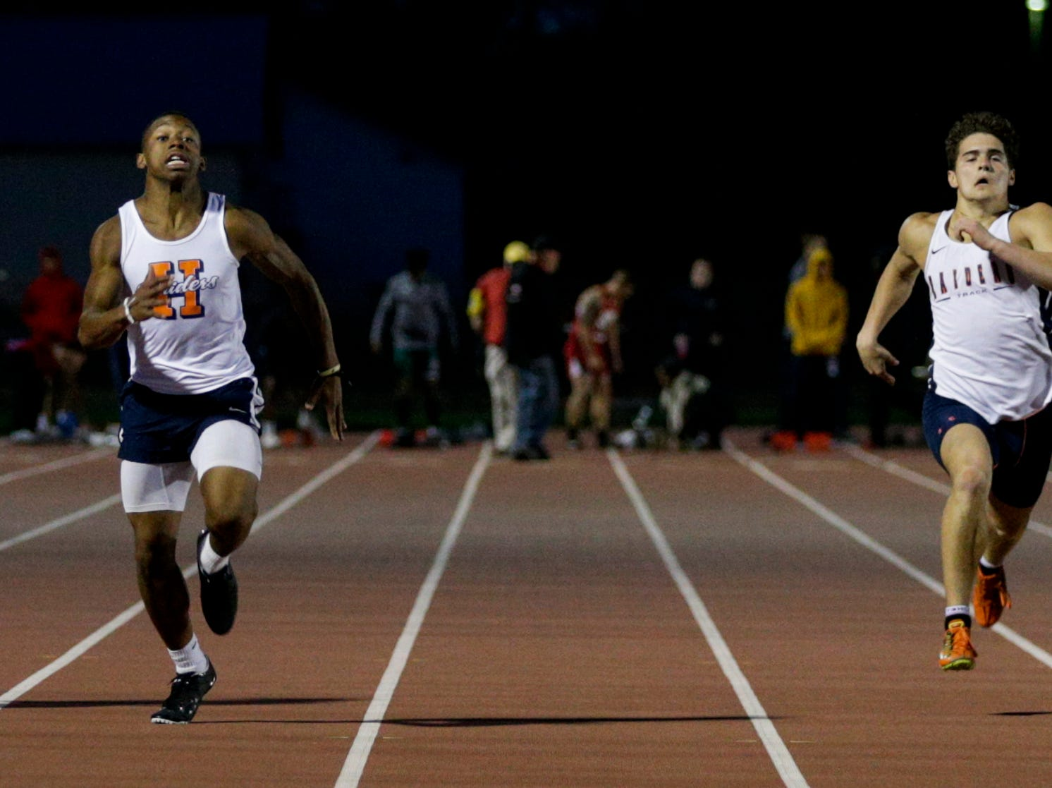 Harrison's Isaiah Armstrong and Quinton Wood compete in the men's 100 meter dash during the 2019 Sprinters Showcase, Friday, April 12, 2019, at Lafayette Jeff High School in Lafayette.