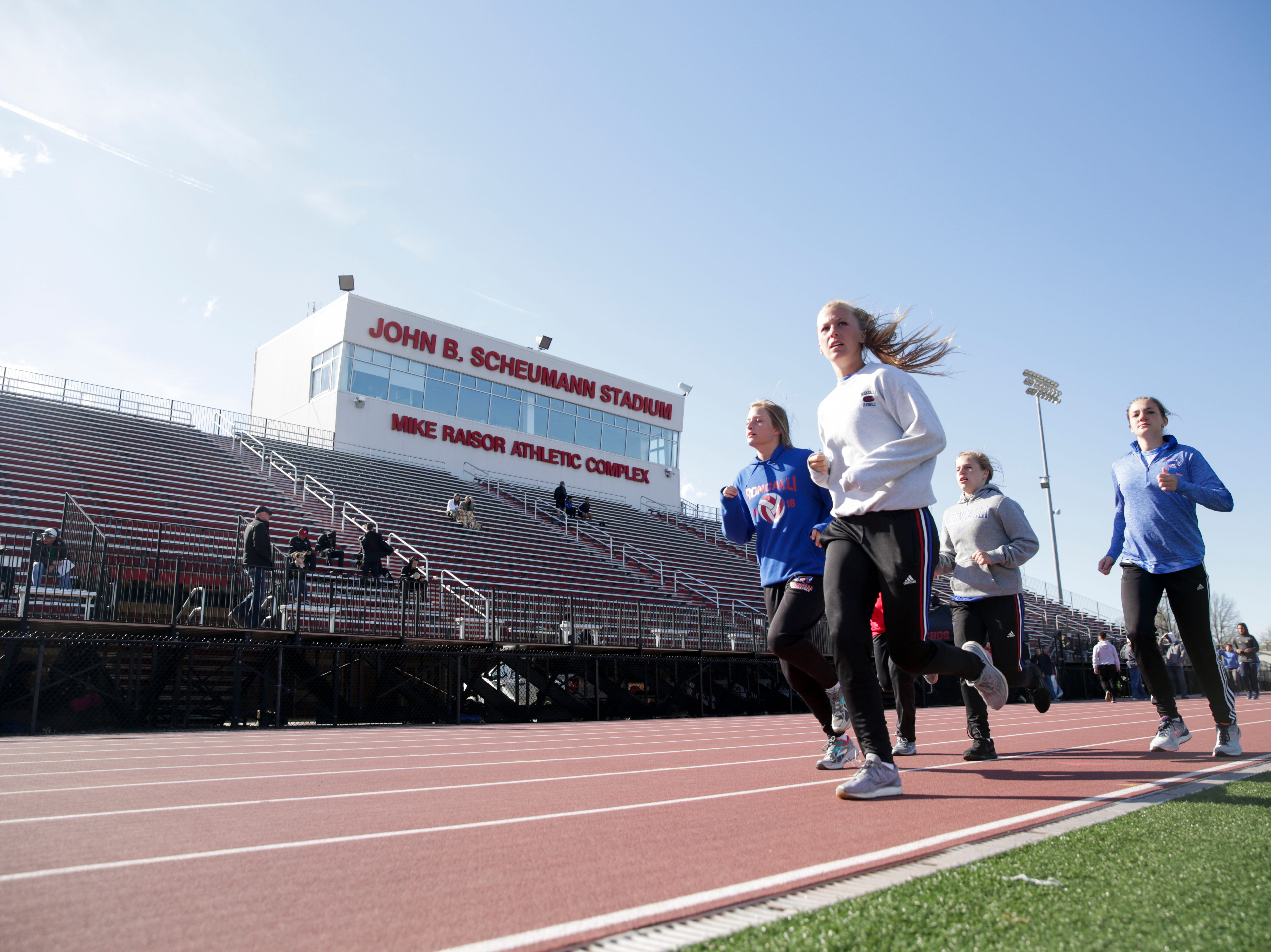 Competitors warm up before the 2019 Sprinters Showcase, Friday, April 12, 2019, at Lafayette Jeff High School in Lafayette.