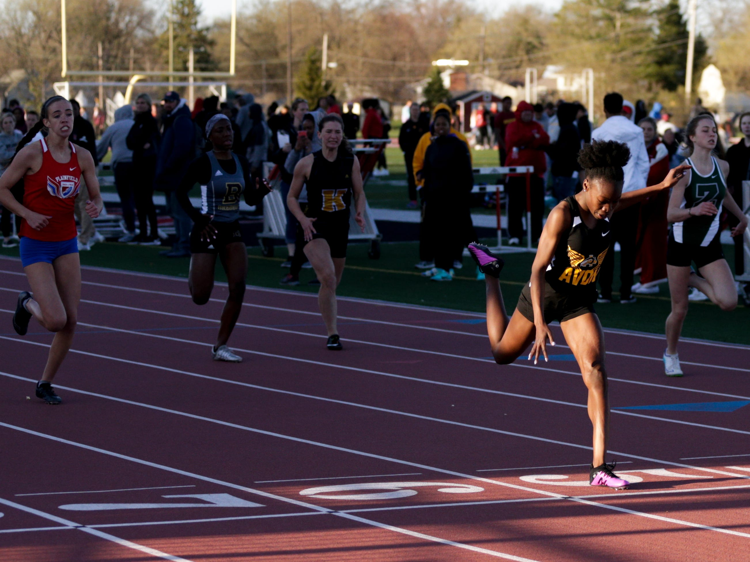 Avon's Alana Springer crosses the finish line in the women's 200 meter dash during the 2019 Sprinters Showcase, Friday, April 12, 2019, at Lafayette Jeff High School in Lafayette.