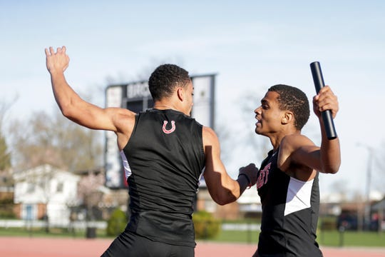 Lafayette Jeff's Bishop Johnson, left, celebrates with Derrick Matthews after winning the 400 meter relay during Friday's Sprinters Showcase event.