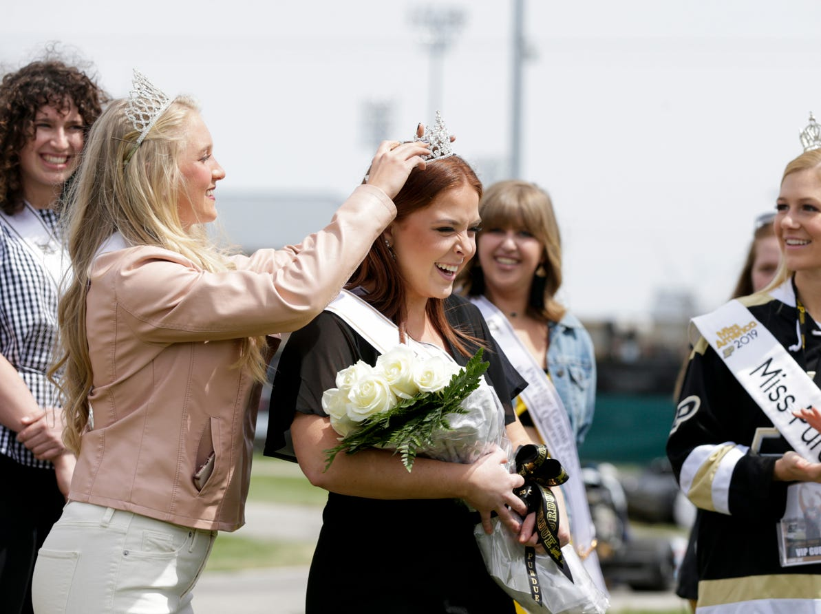 Marin Parker, center, is crowned Miss Purdue Grand Prix 2019 during the 62nd Grand Prix, Saturday, April 13, 2019, in West Lafayette.
