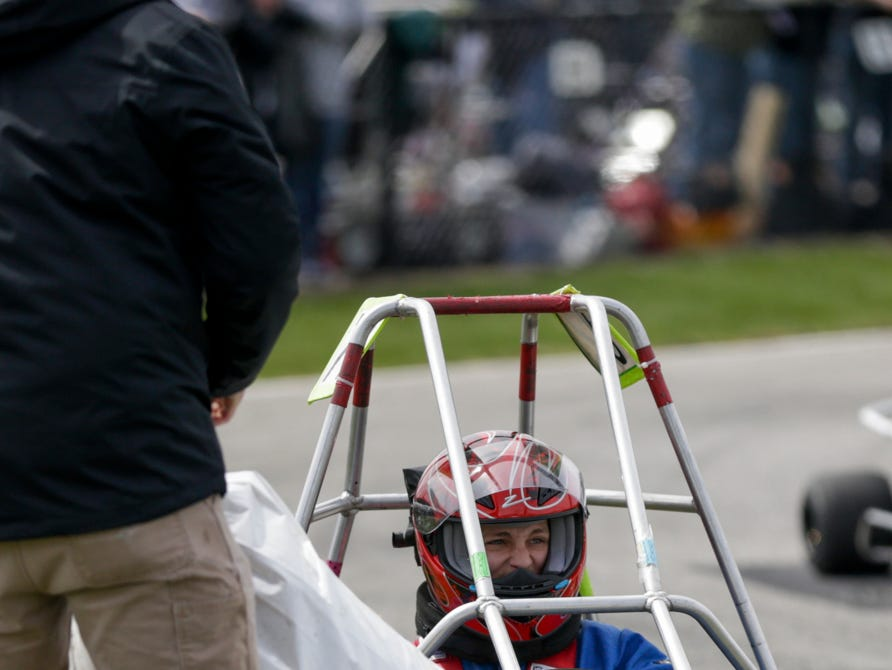 Owen Hall Racing driver Jared Botte (72) waits to be assisted after colliding with hay bails during the 62nd Grand Prix, Saturday, April 13, 2019, in West Lafayette.