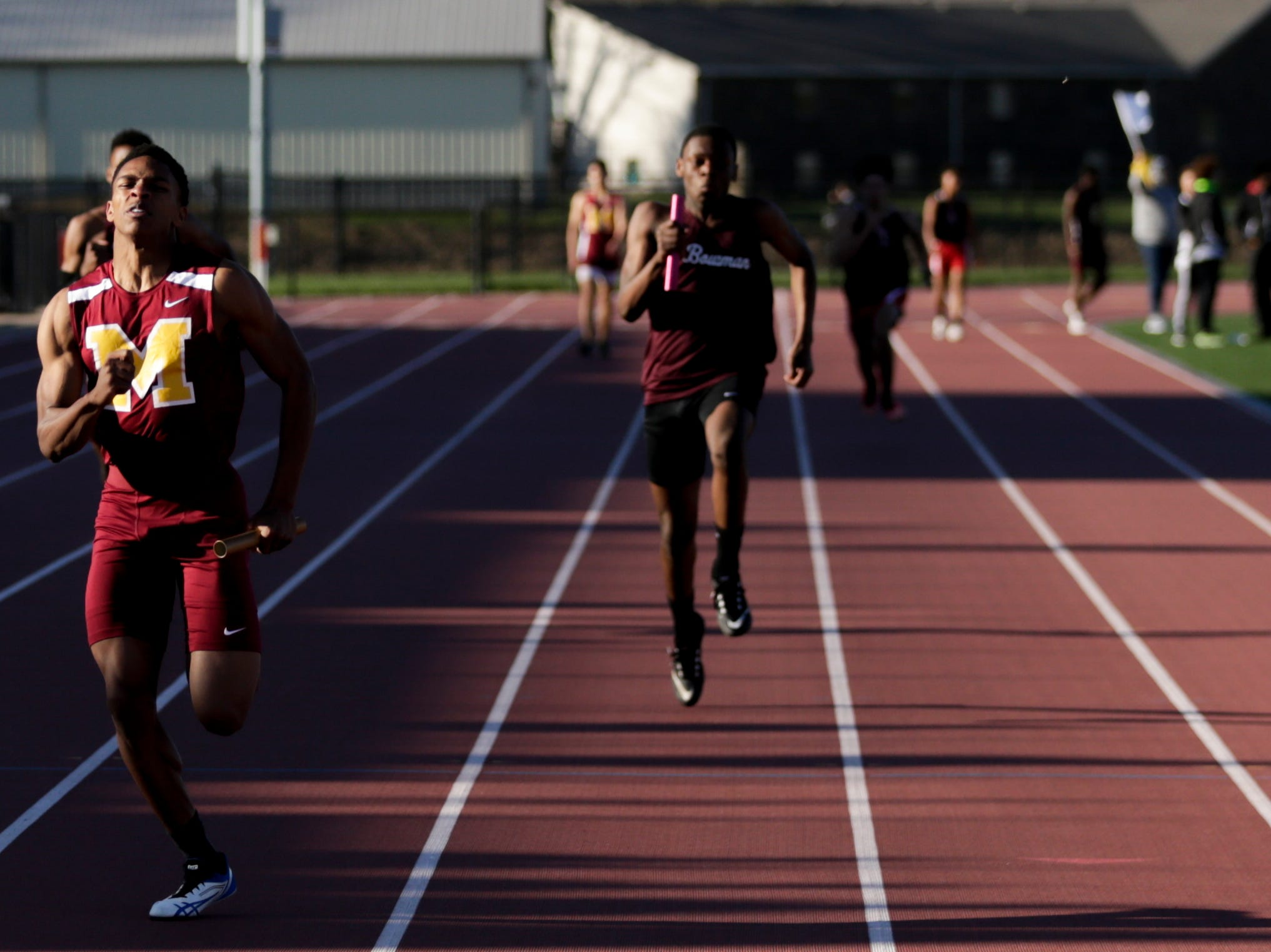McCutcheon runners competes in the men's 4x100 relay during the 2019 Sprinters Showcase, Friday, April 12, 2019, at Lafayette Jeff High School in Lafayette.