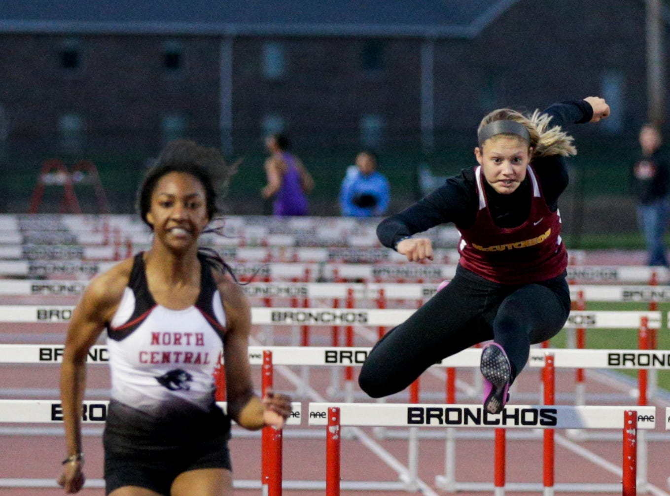 McCutcheon's Shianne Switzer competes in the women's 100 meter hurdles during the 2019 Sprinters Showcase, Friday, April 12, 2019, at Lafayette Jeff High School in Lafayette.