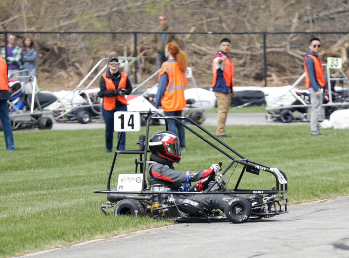 Alpha Sigma Racing driver Kyle Tilley (14) spins out after taking turn one during the 62nd Grand Prix, Saturday, April 13, 2019, in West Lafayette.