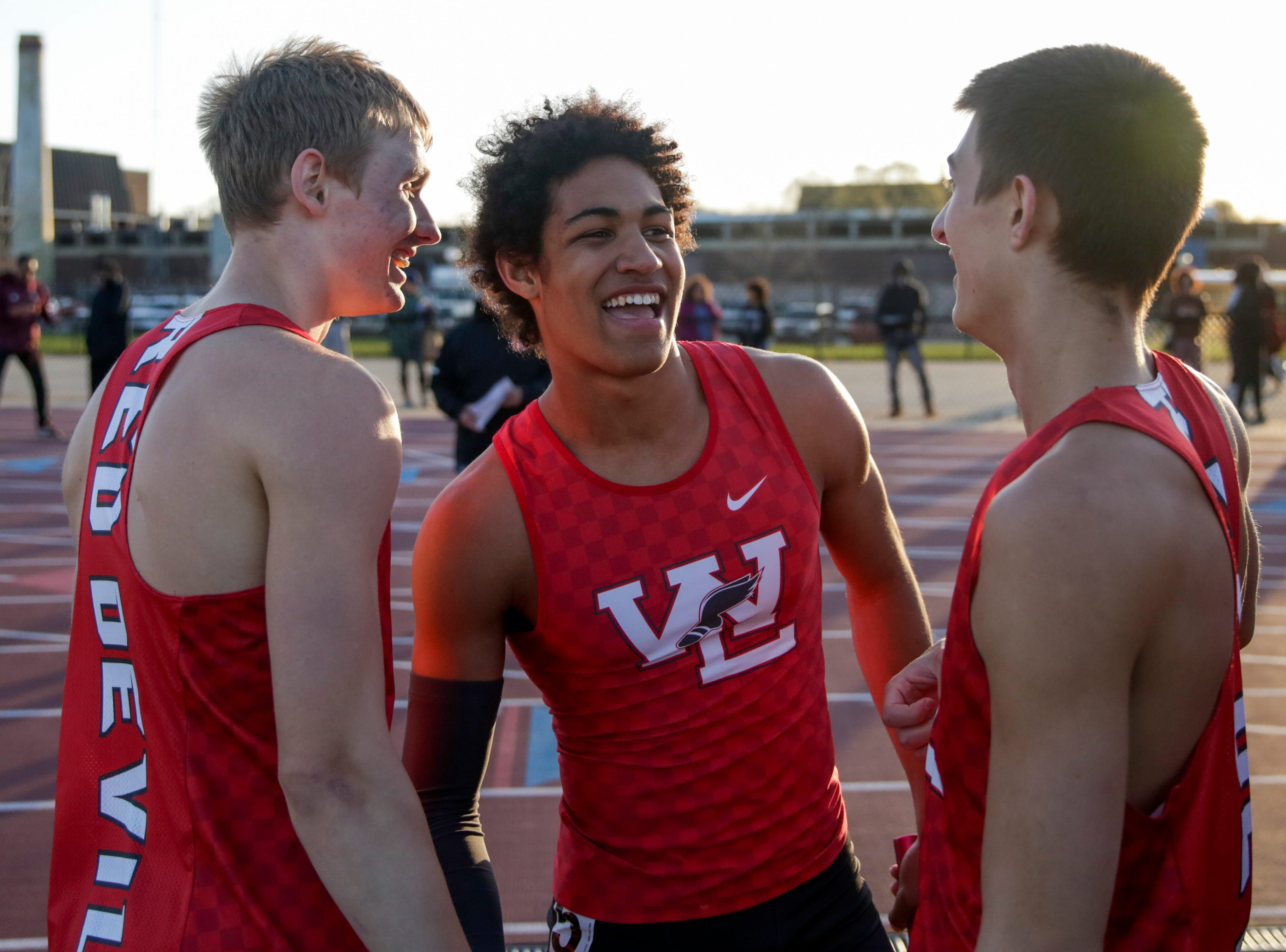 Western Lafayette's Kyle Hazell, center, celebrates with teammates after competing in the men's 4x400 meter relay during the 2019 Sprinters Showcase, Friday, April 12, 2019, at Lafayette Jeff High School in Lafayette.