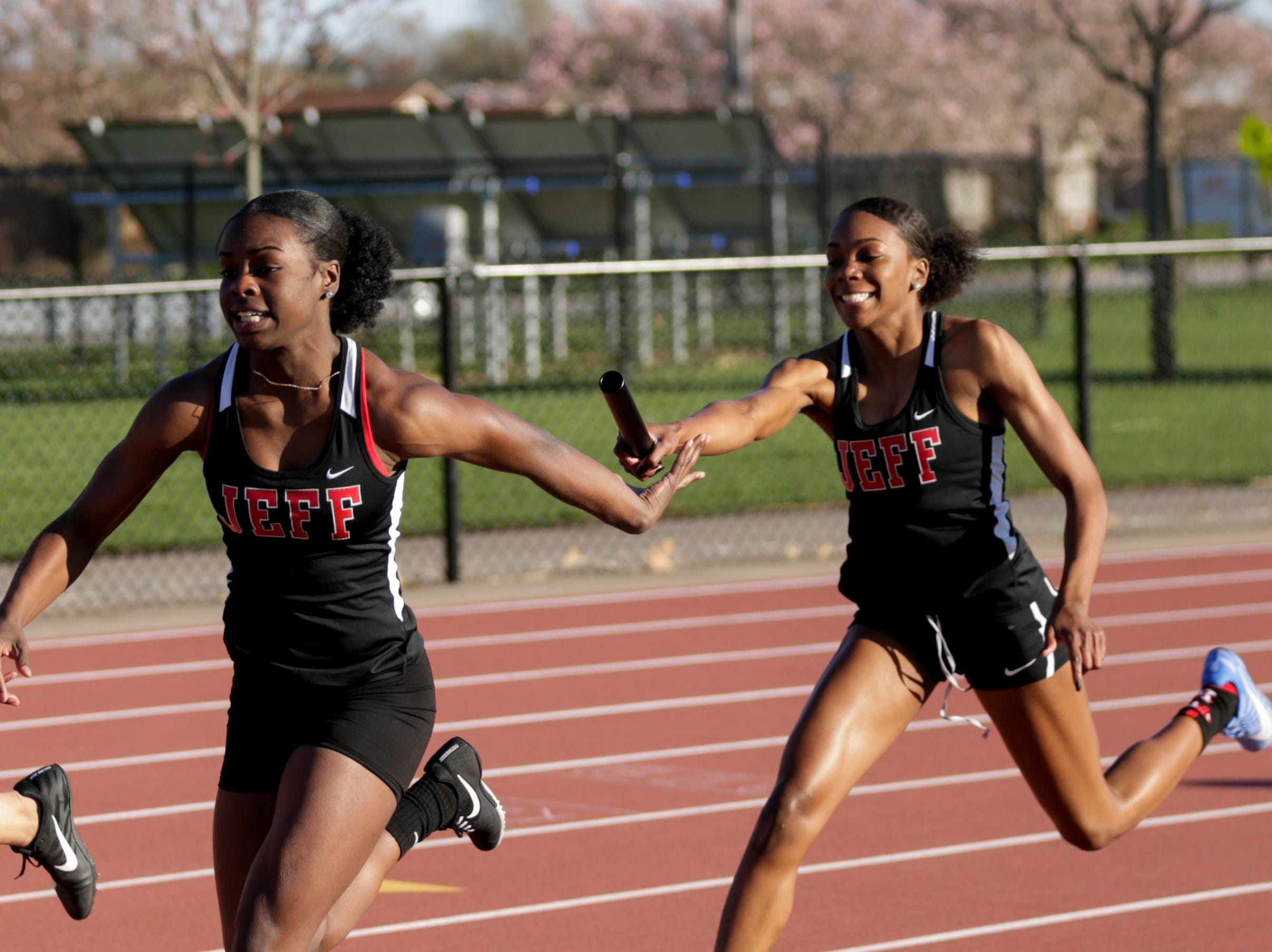 Lafayette Jeff's Kela Haskins hands off the baton to Courtney Beckford as they compete in the women's 4x100 meter relay during the 2019 Sprinters Showcase, Friday, April 12, 2019, at Lafayette Jeff High School in Lafayette.