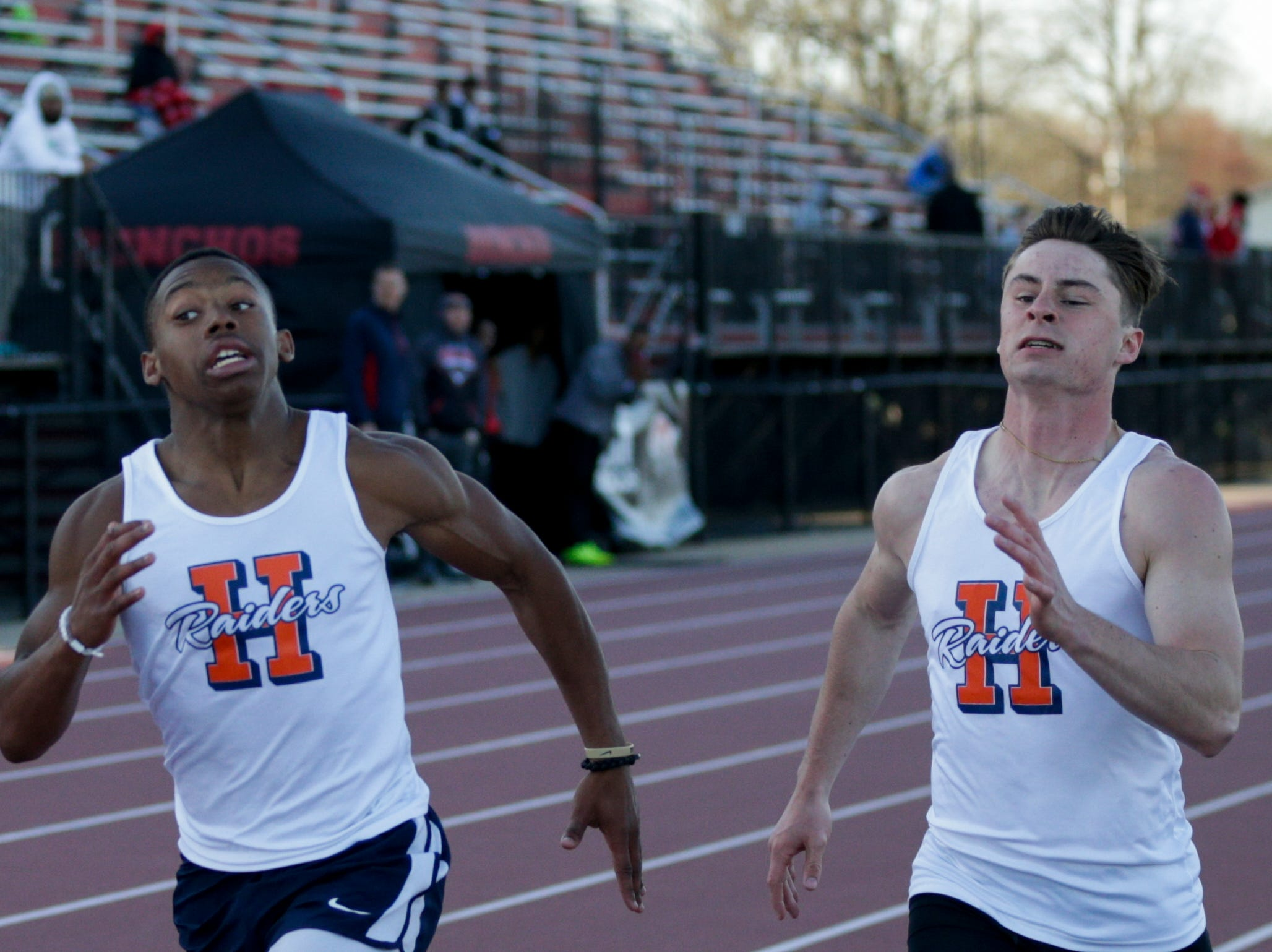 Harrison's Isaiah Armstrong, left, and Stevie Coffing compete in the men's 200 meter dash during the 2019 Sprinters Showcase, Friday, April 12, 2019, at Lafayette Jeff High School in Lafayette.