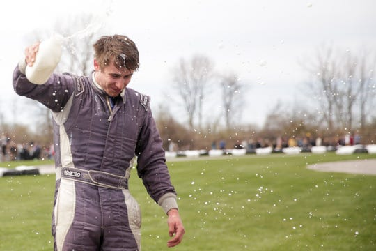 IUPUI Motorsports car 4 driver Brenden Johnson celebrates after winning the 62nd Purdue Grand Prix, Saturday, April 13, 2019, in West Lafayette.