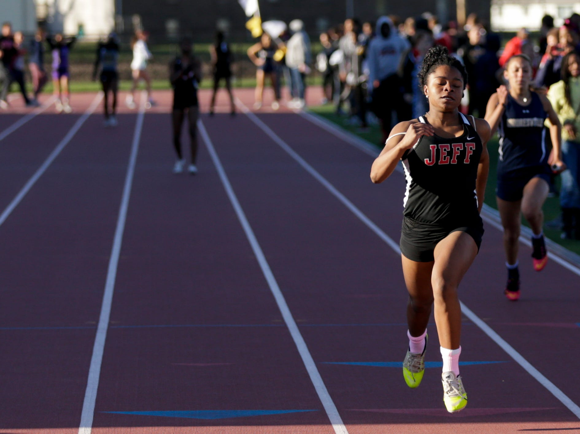 Lafayette Jeff relay runner competes in the women's 4x100 meter relay during the 2019 Sprinters Showcase, Friday, April 12, 2019, at Lafayette Jeff High School in Lafayette.