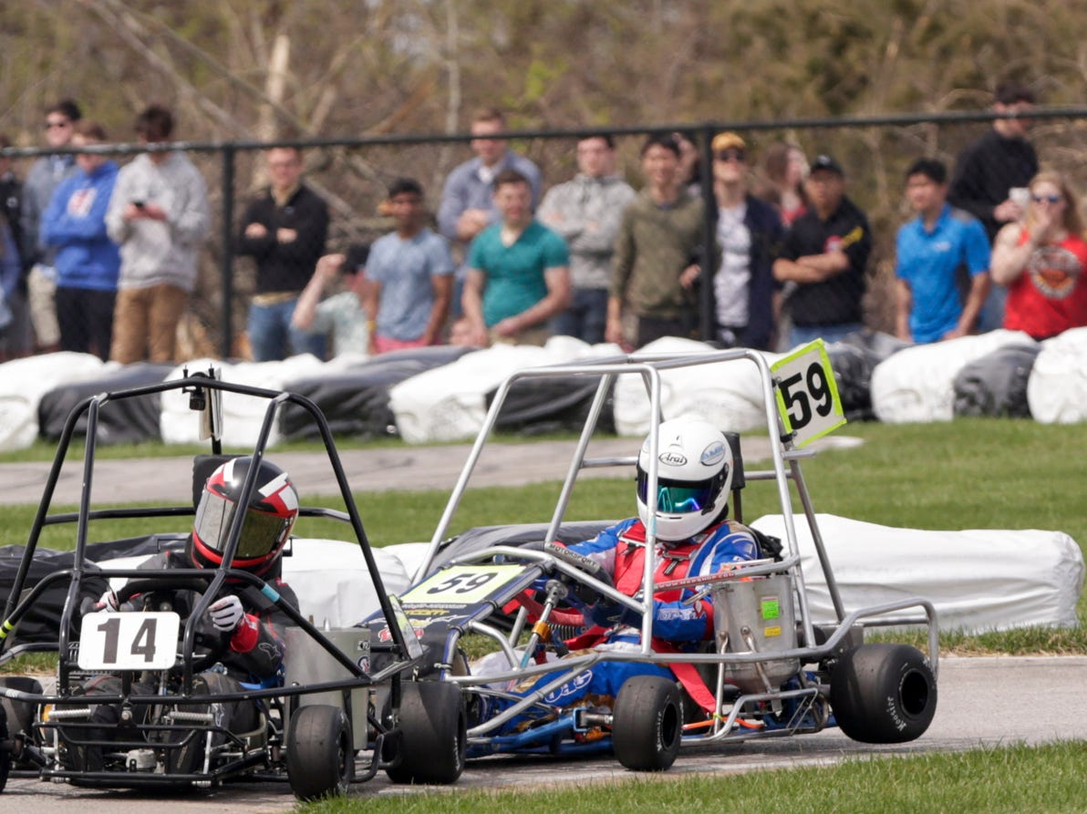 Acacia Racing driver Alexander Kardashian (59) and Alpha Sigma Racing driver Kyle Tilley (14) take turn one during the 62nd Grand Prix, Saturday, April 13, 2019, in West Lafayette.