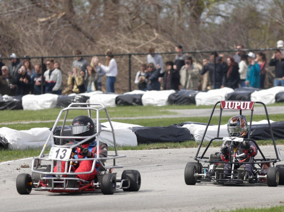 IUPUI Motorsports driver Brenden Johnson (4) comes up on Purdue Student Veterans Organization driver Jesse McClung (13) during the 62nd Grand Prix, Saturday, April 13, 2019, in West Lafayette.