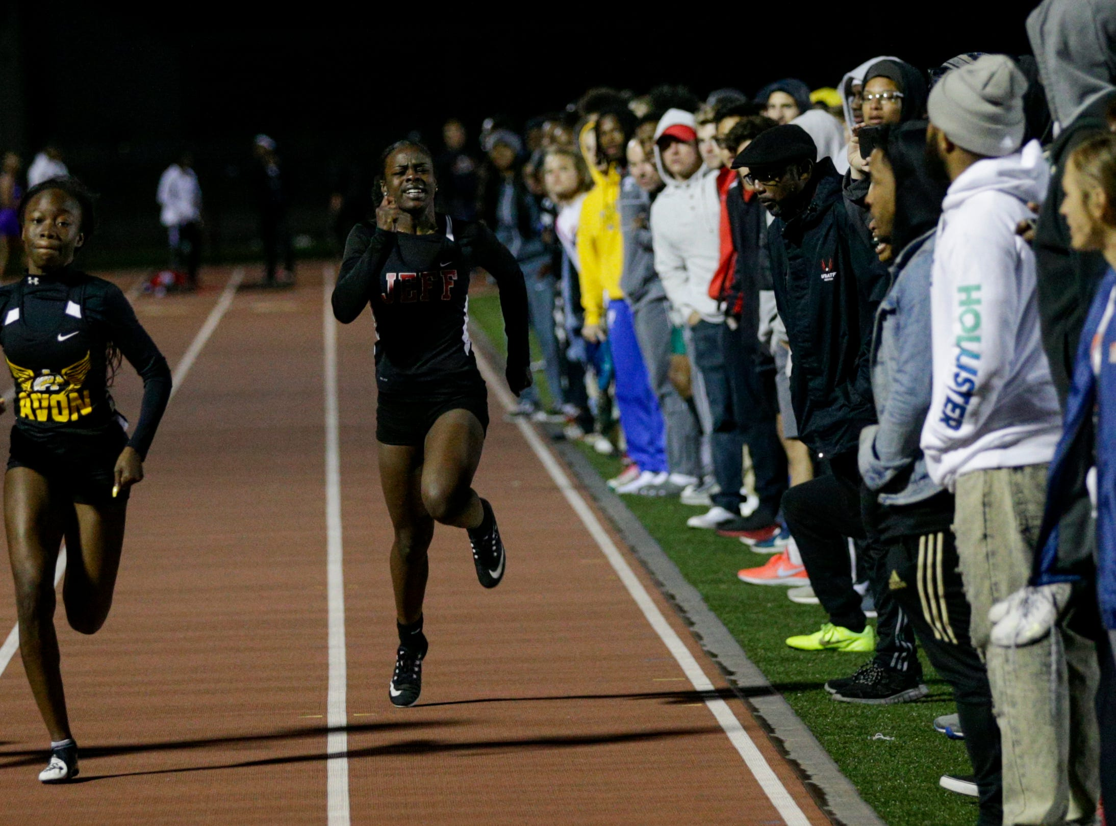 Lafayette Jeff's Courtney Beckford, center, competes in the women's 100 meter dash during the 2019 Sprinters Showcase, Friday, April 12, 2019, at Lafayette Jeff High School in Lafayette.