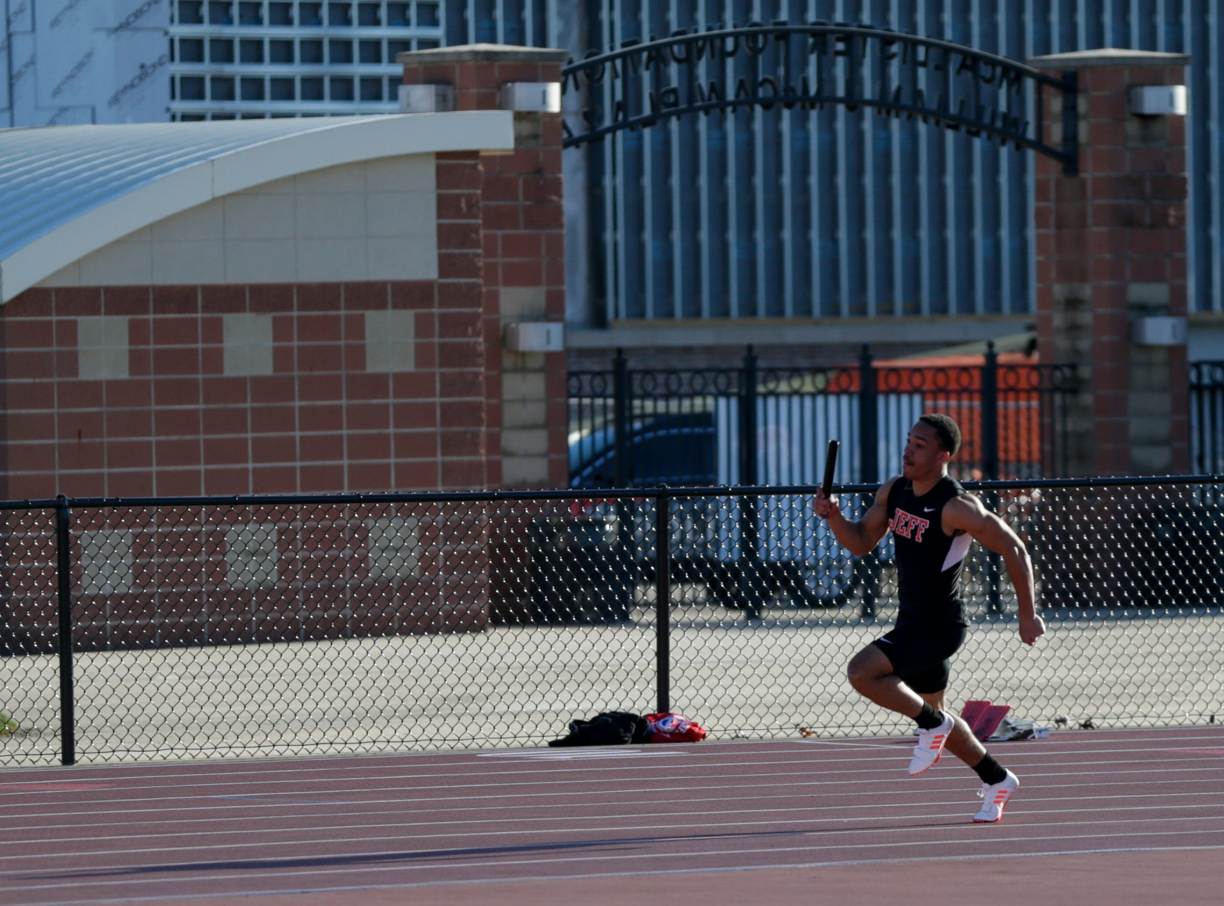 Lafayette Jeff's Bishop Johnson competes in the men's 4x100 meter relay during the 2019 Sprinters Showcase, Friday, April 12, 2019, at Lafayette Jeff High School in Lafayette.