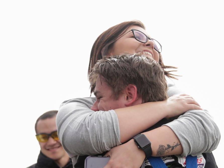 IUPUI Motorsports car 4 driver Brenden Johnson embraces his girlfriend, Lauren Weil after winning the 62nd Purdue Grand Prix, Saturday, April 13, 2019, in West Lafayette.