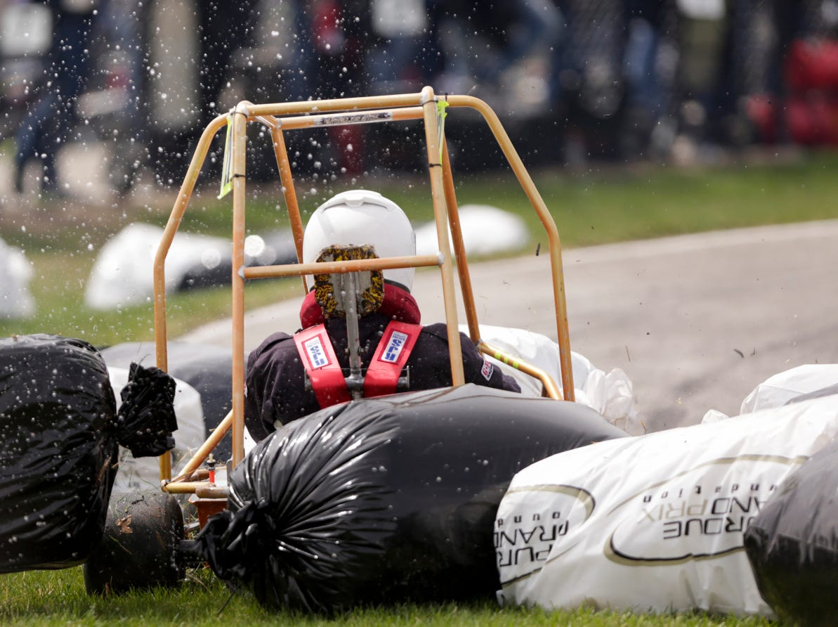 Pi Kappa Phi driver Samy Elmofty (22) collides with hay bails during the 62nd Grand Prix, Saturday, April 13, 2019, in West Lafayette.