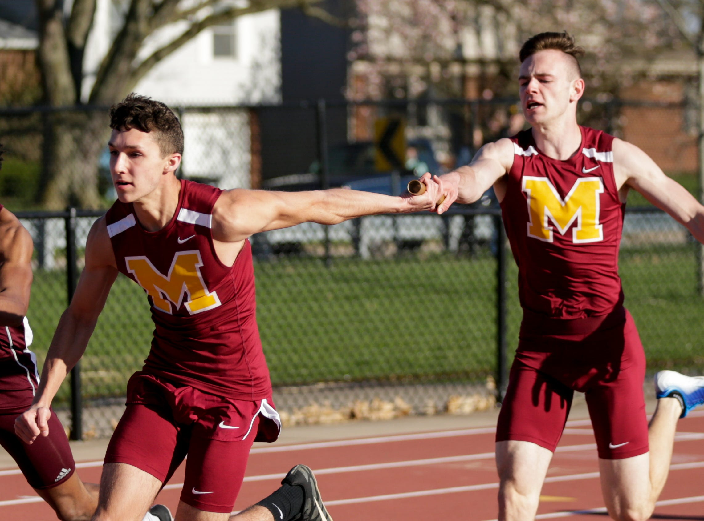 McCutcheon's Garrett Tucker hands off to Justin Crowe as they compete in the men's 4x100 meter relay during the 2019 Sprinters Showcase, Friday, April 12, 2019, at Lafayette Jeff High School in Lafayette.