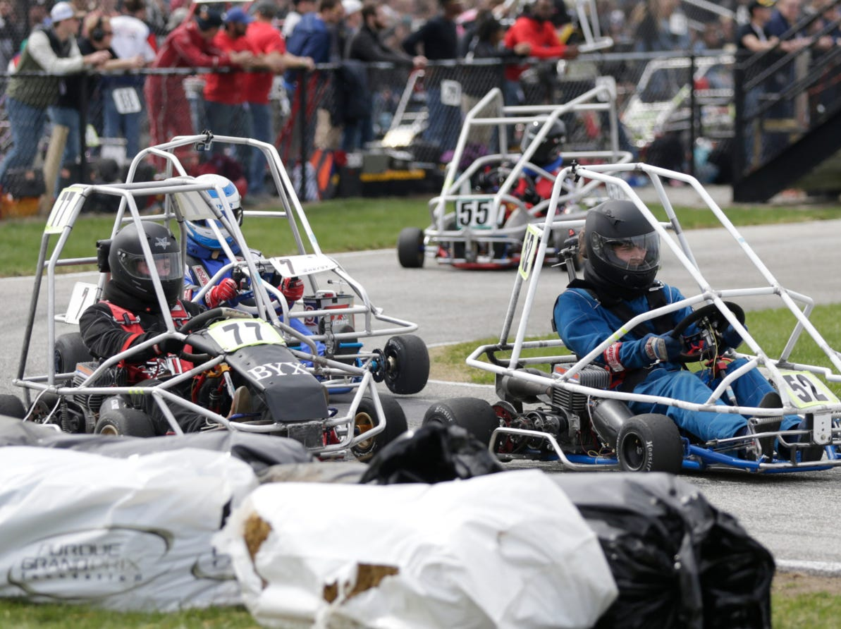 PCS Racing driver Phillip Blankenberger (52) and Beta Upsilon Chi Racing driver Neal Snapp (77) take turn one during the 62nd Grand Prix, Saturday, April 13, 2019, in West Lafayette.
