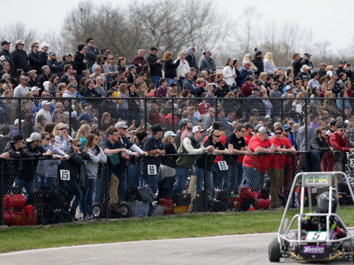 Spectators watch the track during the 62nd Grand Prix, Saturday, April 13, 2019, in West Lafayette.