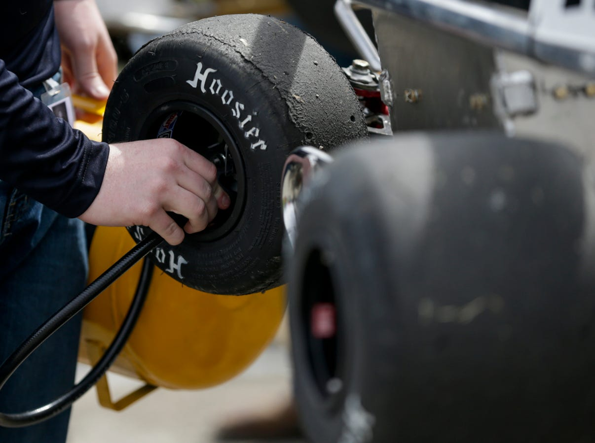 A crew member checks the air pressure in a tire during the 62nd Grand Prix, Saturday, April 13, 2019, in West Lafayette.