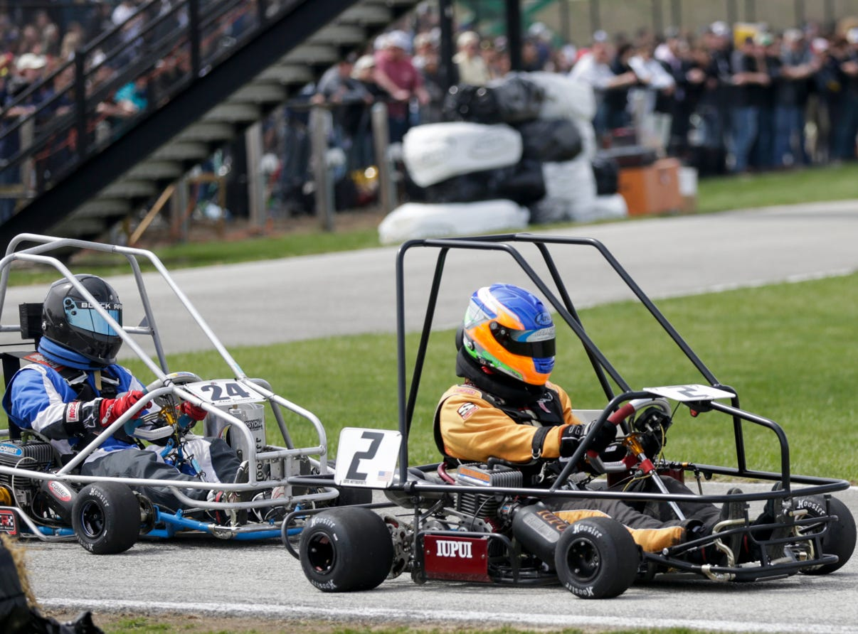 IUPUI Motorsports driver Jared Thomas (2) passes Cary Racing driver Adam Jennerjahn (24) during the 62nd Grand Prix, Saturday, April 13, 2019, in West Lafayette.