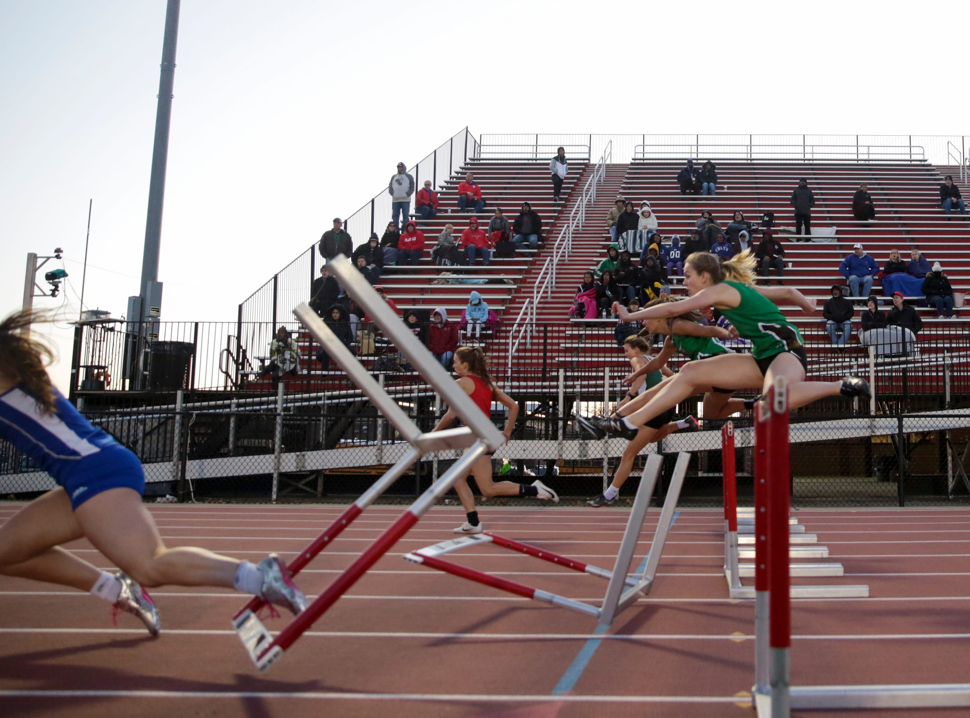 Runners fall while competing in the women's 100 meter hurdles during the 2019 Sprinters Showcase, Friday, April 12, 2019, at Lafayette Jeff High School in Lafayette.