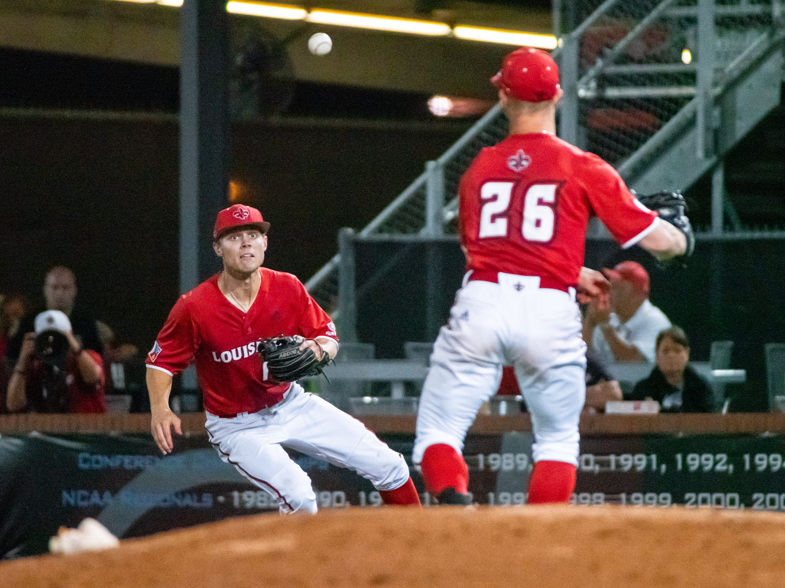 """UL's Hunter Kasuls prepares to catch a throw to first base to get the runner out as the Ragin' Cajuns take on the South Alabama Jaguars at M.L. """"Tigue"""" Moore Field on Friday, April 4, 2019."""