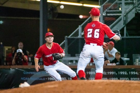 Daniel Lahare (26) throw to Hunter Kasuls at first base in UL's 9-2 loss to South Alabama on Friday night at The Tigue.