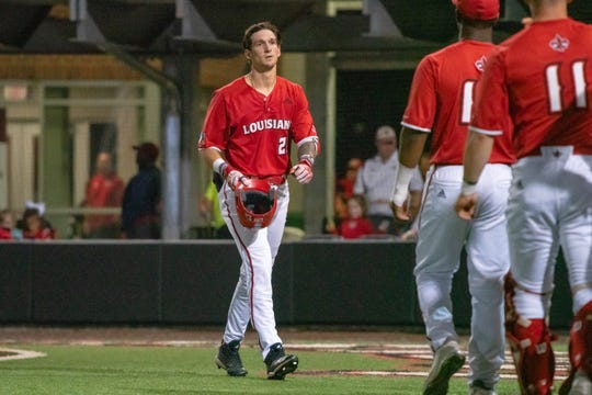 UL's Orynn Veillon is welcomed back to the dugout after he homered against South Alabama last Friday.