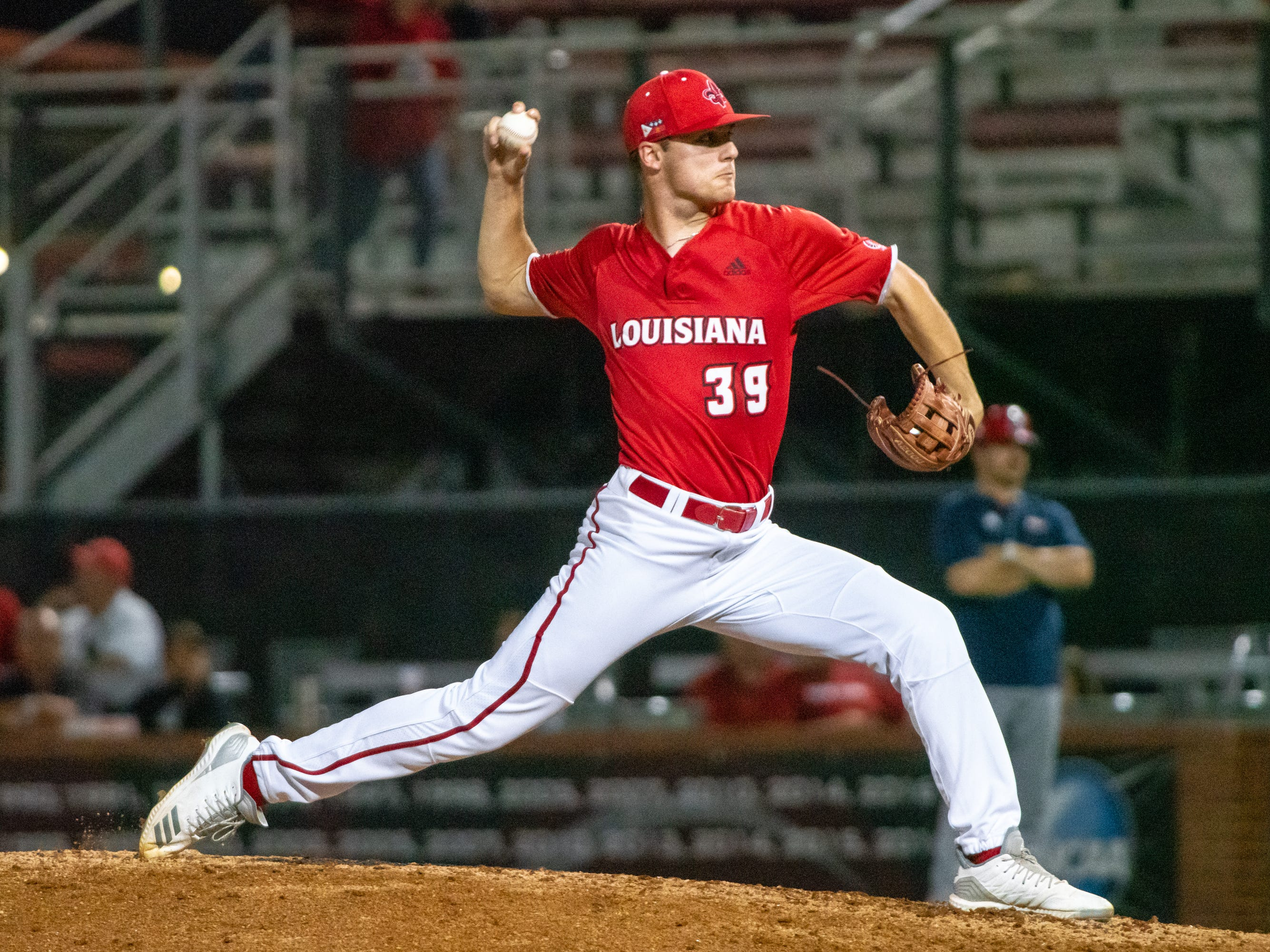 """UL's Michael Leaumont winds up a pitch on the mound as the Ragin' Cajuns take on the South Alabama Jaguars at M.L. """"Tigue"""" Moore Field on Friday, April 4, 2019."""