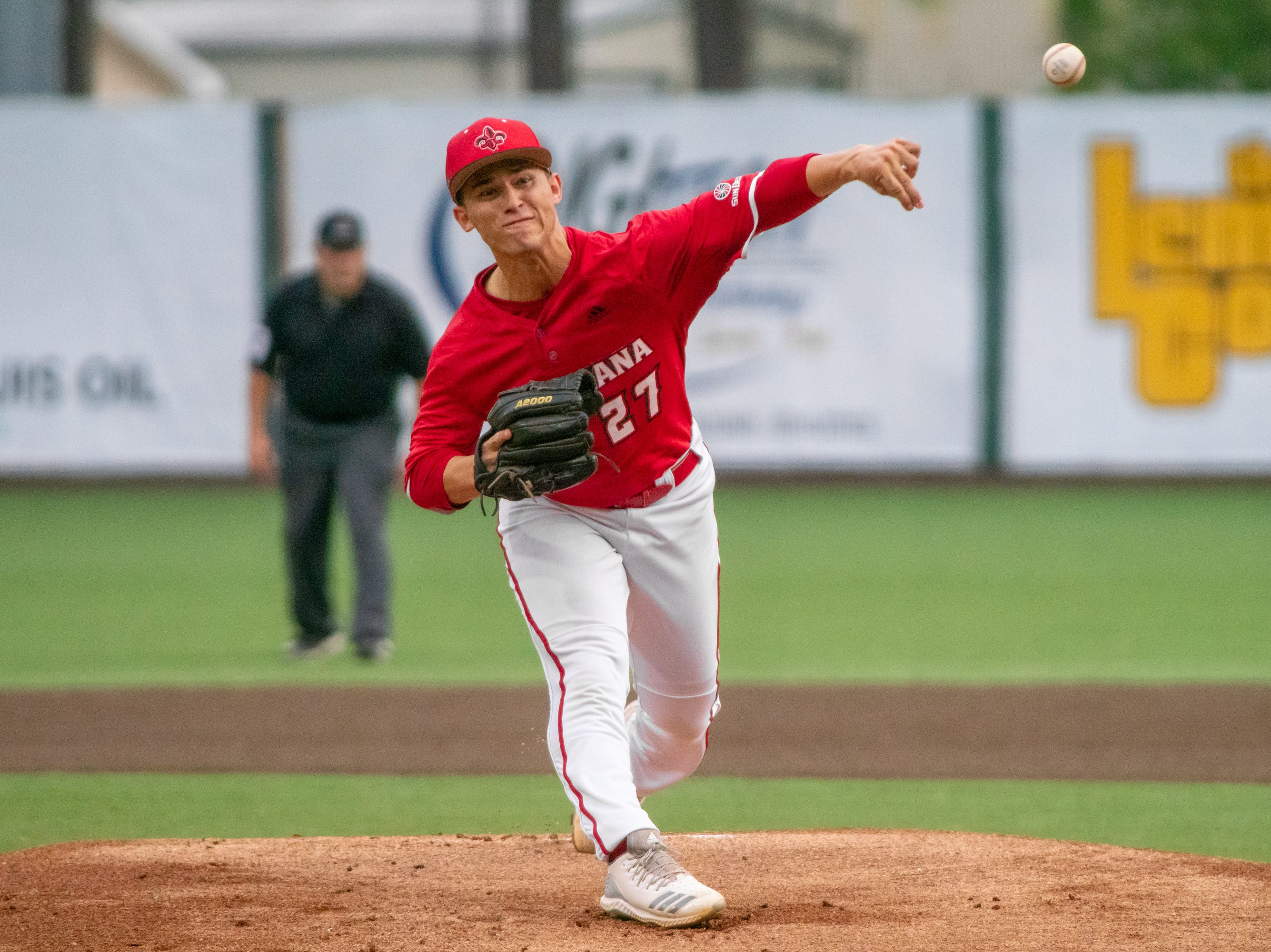 """UL's pitcher Austin Perrin throws to the batter as the Ragin' Cajuns take on the South Alabama Jaguars at M.L. """"Tigue"""" Moore Field on Friday, April 4, 2019."""