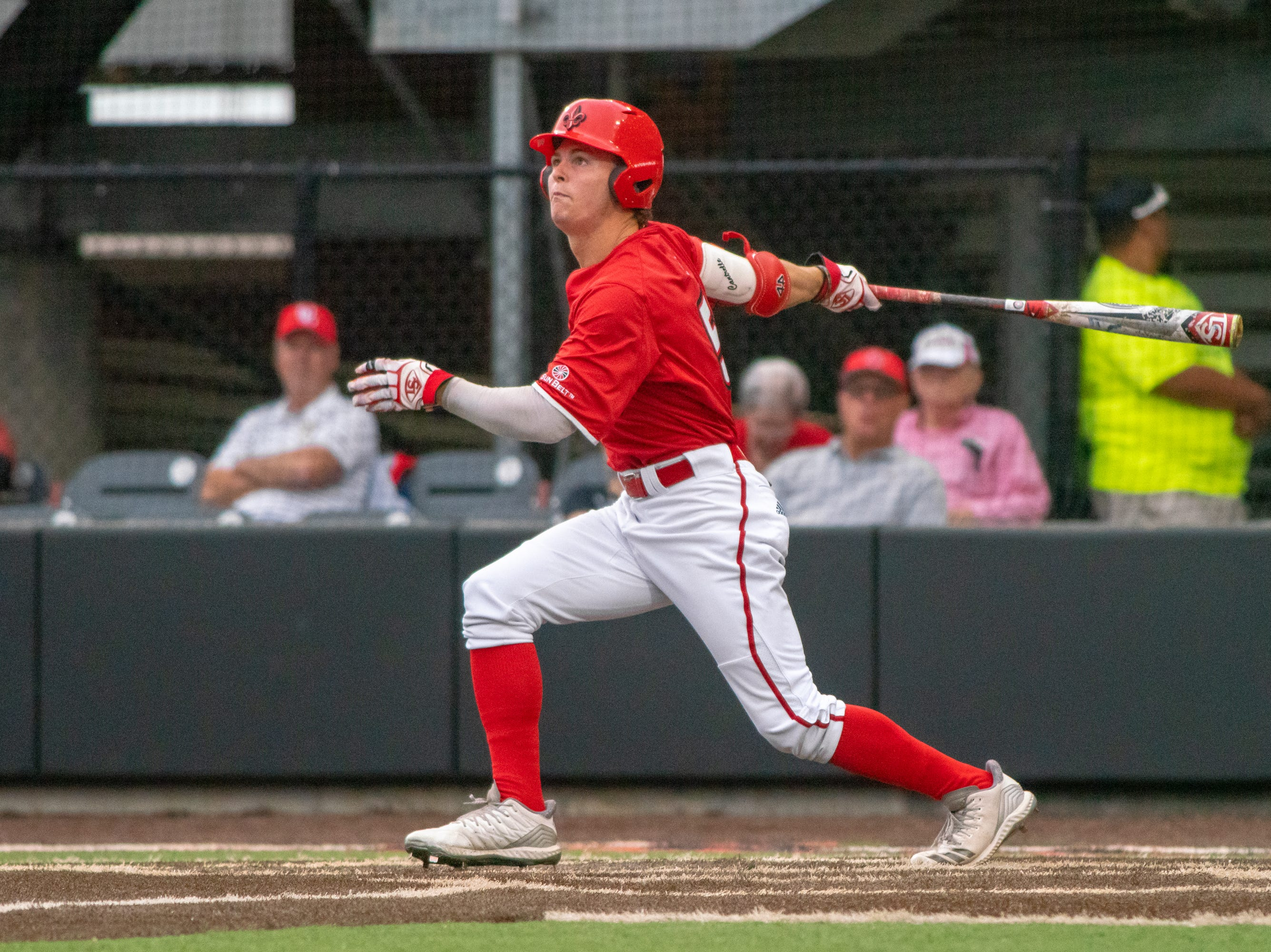 """UL's Hayden Cantrelle watches the ball fly as the Ragin' Cajuns take on the South Alabama Jaguars at M.L. """"Tigue"""" Moore Field on Friday, April 4, 2019."""