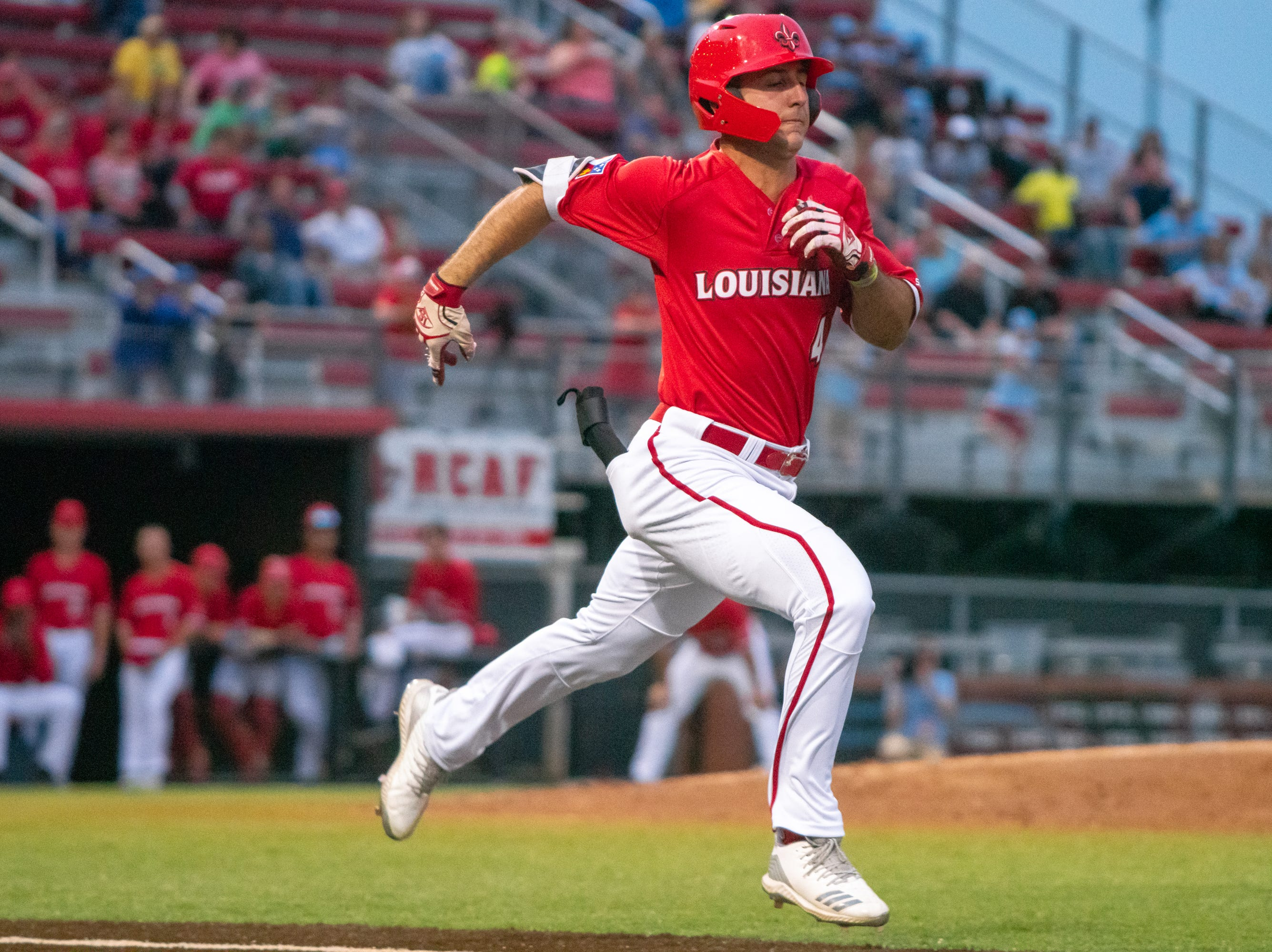 """UL's Brennan Breaux rushes to first base as the Ragin' Cajuns take on the South Alabama Jaguars at M.L. """"Tigue"""" Moore Field on Friday, April 4, 2019."""