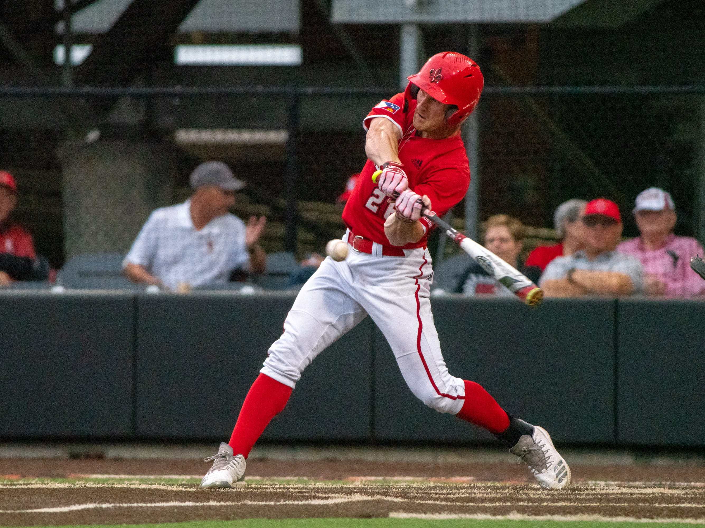 """UL's Daniel Lahare hits the ball as the Ragin' Cajuns take on the South Alabama Jaguars at M.L. """"Tigue"""" Moore Field on Friday, April 4, 2019."""