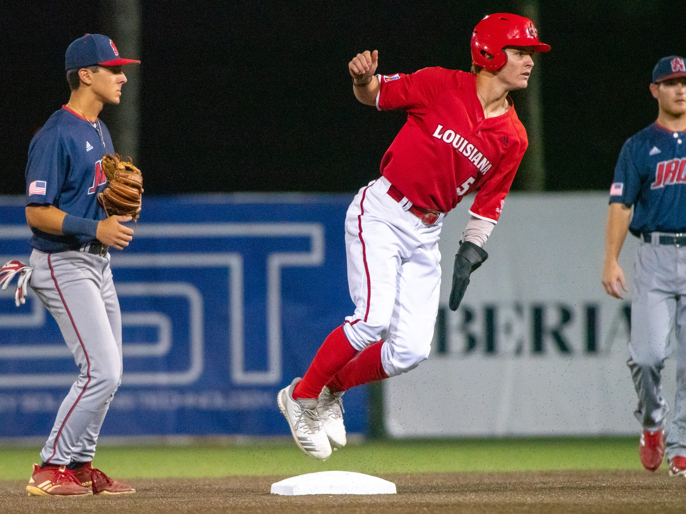 """UL's Hayden Cantrelle slides safe onto second base as the Ragin' Cajuns take on the South Alabama Jaguars at M.L. """"Tigue"""" Moore Field on Friday, April 4, 2019."""